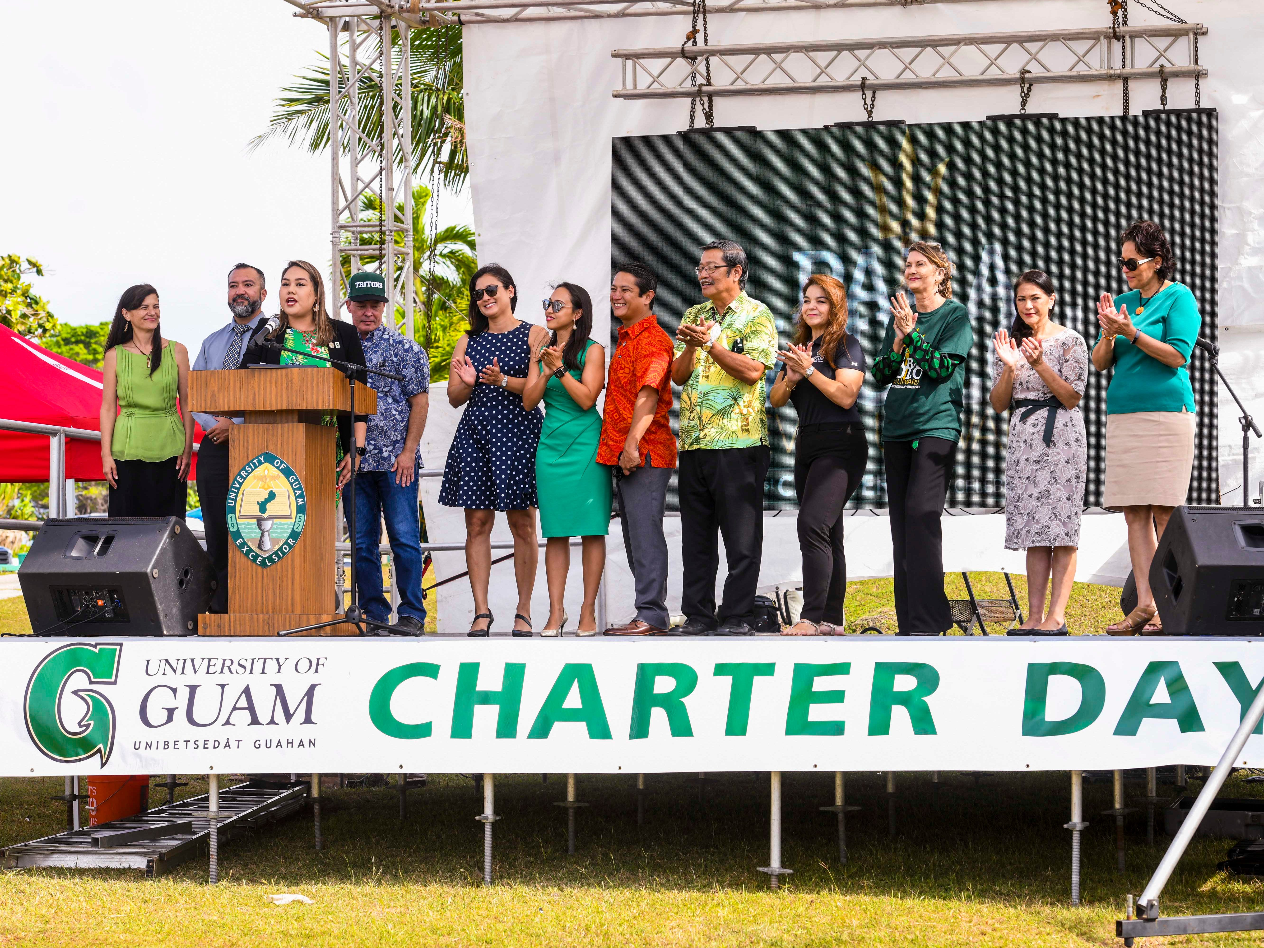 Sen. Amanda Shelton is joined by fellow lawmakers as they prepare to present faculty members with a legislative resolution during the University of Guam 51st Charter Day celebration in Mangilao on Tuesday, March 12, 2019.