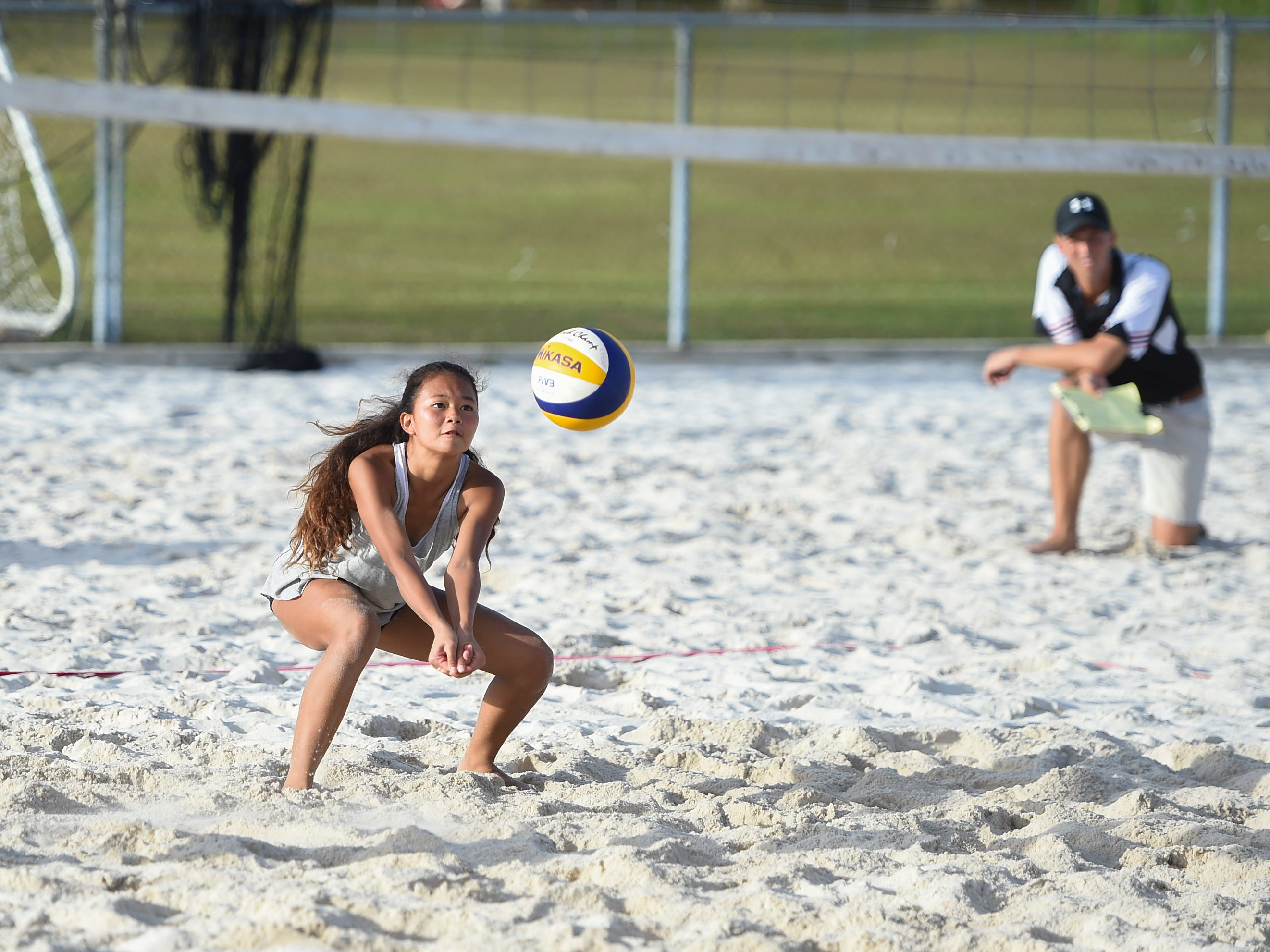 Yasmeen Lopez competes during the IIAAG Beach Volleyball championship game at the Guam Football Association National Training Center in Dededo, March 12, 2019.