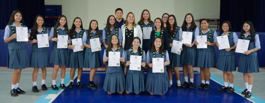 """Senators Regine Biscoe Lee '99 and Amanda Shelton '08, presented the Academy of Our Lady of Guam's basketball team with Certificate Number 5-35 COR on Feb. 27. The team recognized for their performance in Tokyo, Japan, garnered the Championship Title at the January 2019 American School in Japan Kanto Classic Basketball Tournament.  The Cougars competed against teams from Japan, South Korea, Okinawa, Guam, and other countries. """"It's not just celebrating this victory today, but it is also celebrating all those times that our girls felt defeated [yet] they continued to move forward,"""" said Senator Lee. Front row kneeling from left: Myka Jo Terlaje, Katana Guerrero Colbert, Cassidy Tobiason. Back row left: Maria Taitano, Oriana Sevilla, Cori-Nicole Paulino, Kylie McDonald, Katherine Cruz, Annika Almario, Head Coach Jimmy Yi, Senator  Shelton, Mia San Nicolas, Senator Lee, Coach Johana Taimanglo – Valenzuela, Maria Egurrola, Therese Fegurgur, Nicole Gandaoli, Emilee Yamamoto, and Mikaela Bumagat. Not pictured: Alexis Fejeran and Coach Ryan Treltas"""