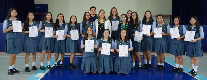 "Senators Regine Biscoe Lee '99 and Amanda Shelton '08, presented the Academy of Our Lady of Guam's basketball team with Certificate Number 5-35 COR on Feb. 27. The team recognized for their performance in Tokyo, Japan, garnered the Championship Title at the January 2019 American School in Japan Kanto Classic Basketball Tournament.  The Cougars competed against teams from Japan, South Korea, Okinawa, Guam, and other countries. ""It's not just celebrating this victory today, but it is also celebrating all those times that our girls felt defeated [yet] they continued to move forward,"" said Senator Lee. Front row kneeling from left: Myka Jo Terlaje, Katana Guerrero Colbert, Cassidy Tobiason. Back row left: Maria Taitano, Oriana Sevilla, Cori-Nicole Paulino, Kylie McDonald, Katherine Cruz, Annika Almario, Head Coach Jimmy Yi, Senator  Shelton, Mia San Nicolas, Senator Lee, Coach Johana Taimanglo – Valenzuela, Maria Egurrola, Therese Fegurgur, Nicole Gandaoli, Emilee Yamamoto, and Mikaela Bumagat. Not pictured: Alexis Fejeran and Coach Ryan Treltas"