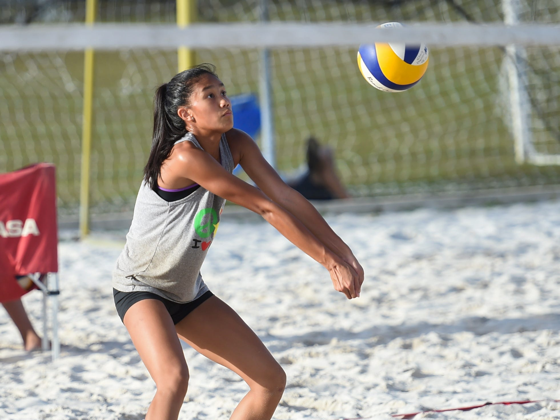 St. John's Knights White's Kristen Serrano positions to bump the ball during the IIAAG Beach Volleyball championship game at the Guam Football Association National Training Center in Dededo, March 12, 2019.
