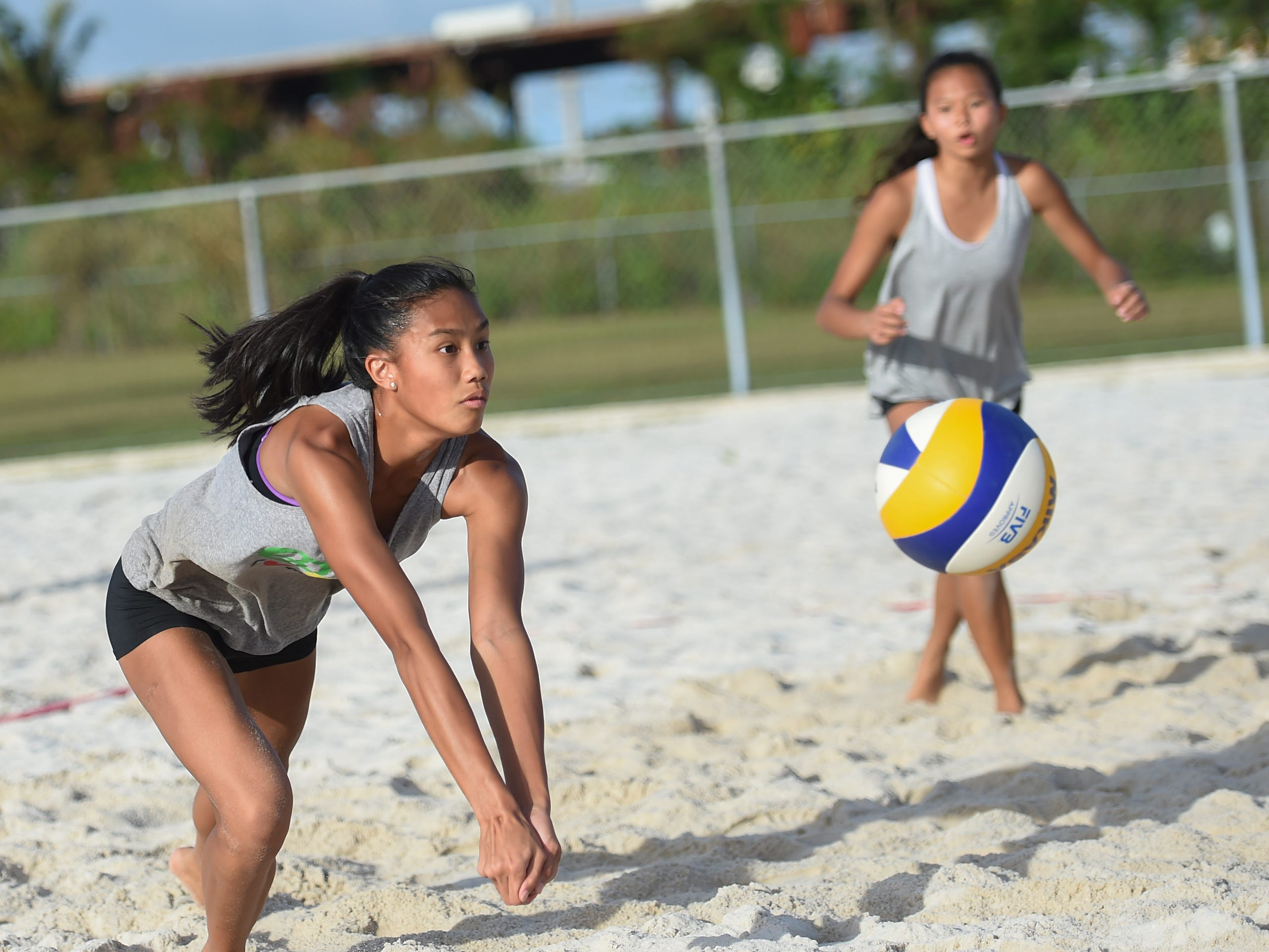 St. John's player Kristen Serrano competes during the IIAAG Beach Volleyball championship game at the Guam Football Association National Training Center in Dededo, March 12, 2019.