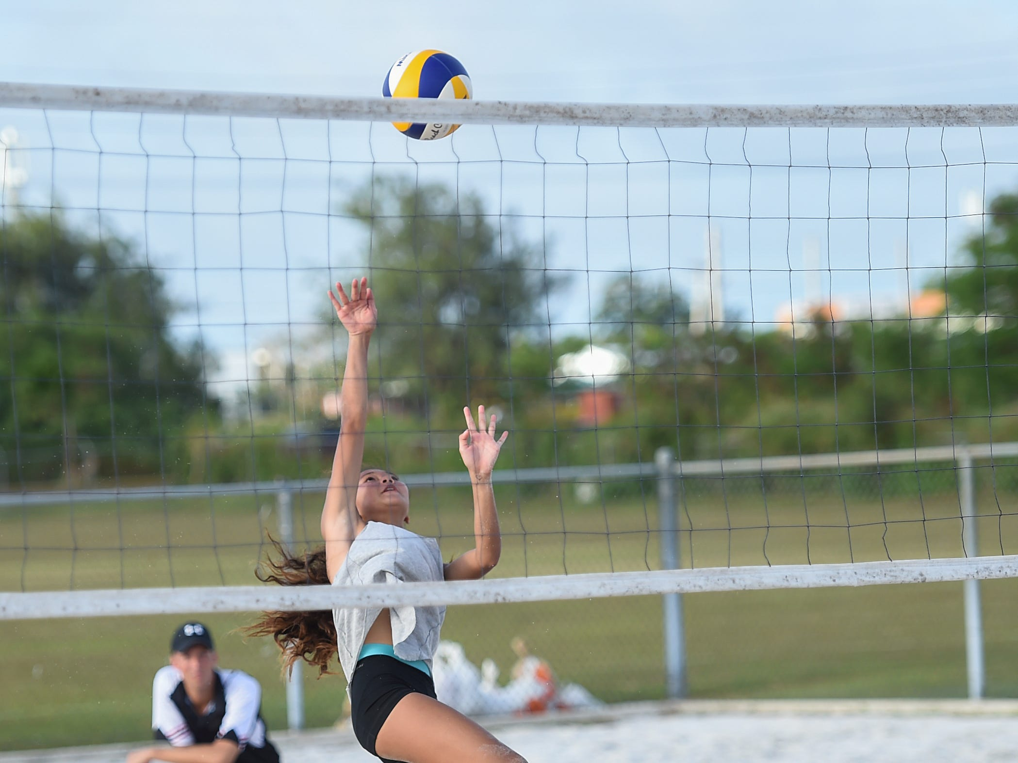 Yasmeen Lopez volleys during the IIAAG Beach Volleyball championship game at the Guam Football Association National Training Center in Dededo, March 12, 2019.