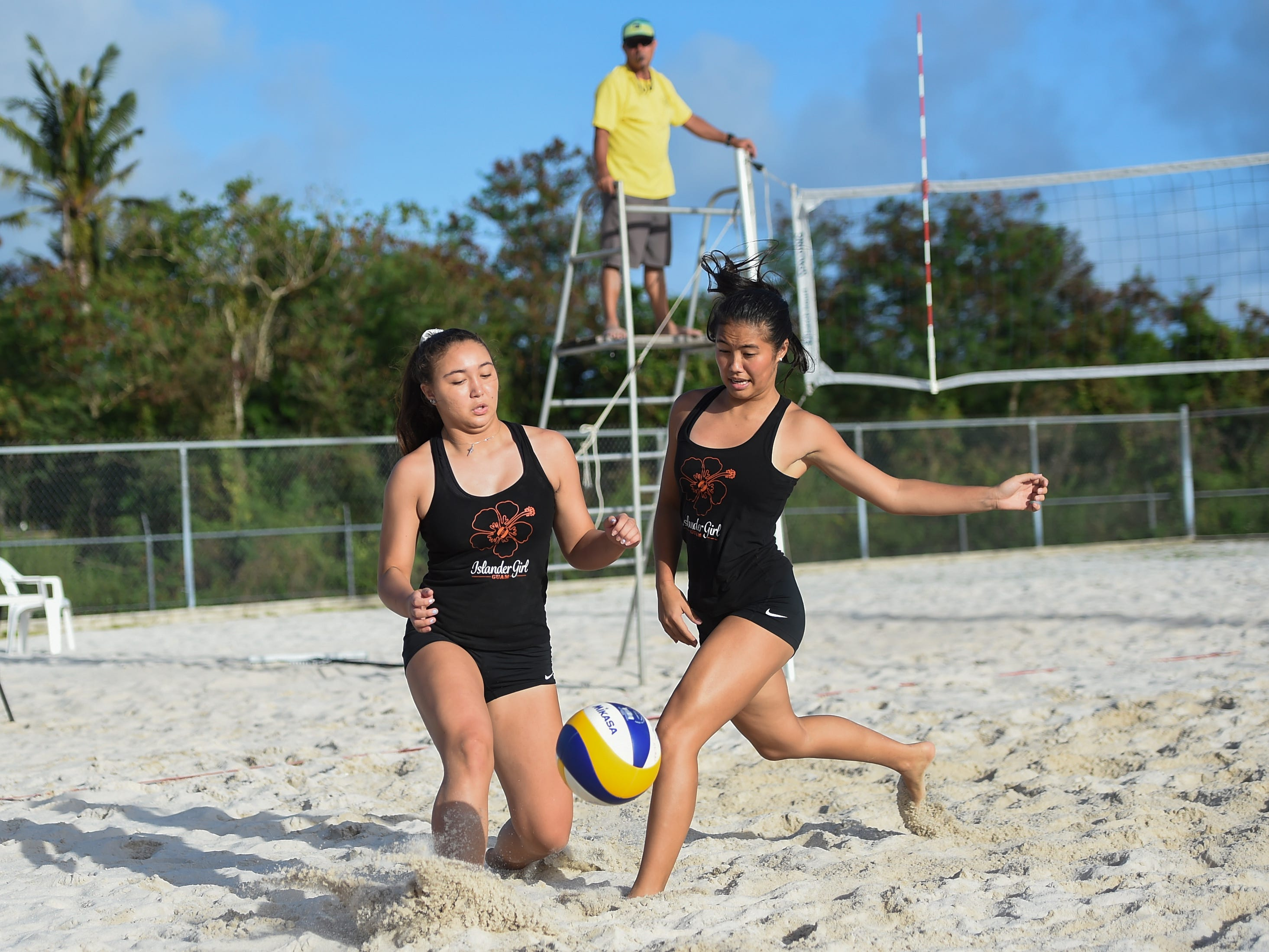 St. John's Knights White teammates Hallie Wigsten, right, and Tylee Shepherd misjudge a volley during the IIAAG Beach Volleyball championship game at the Guam Football Association National Training Center in Dededo, March 12, 2019.