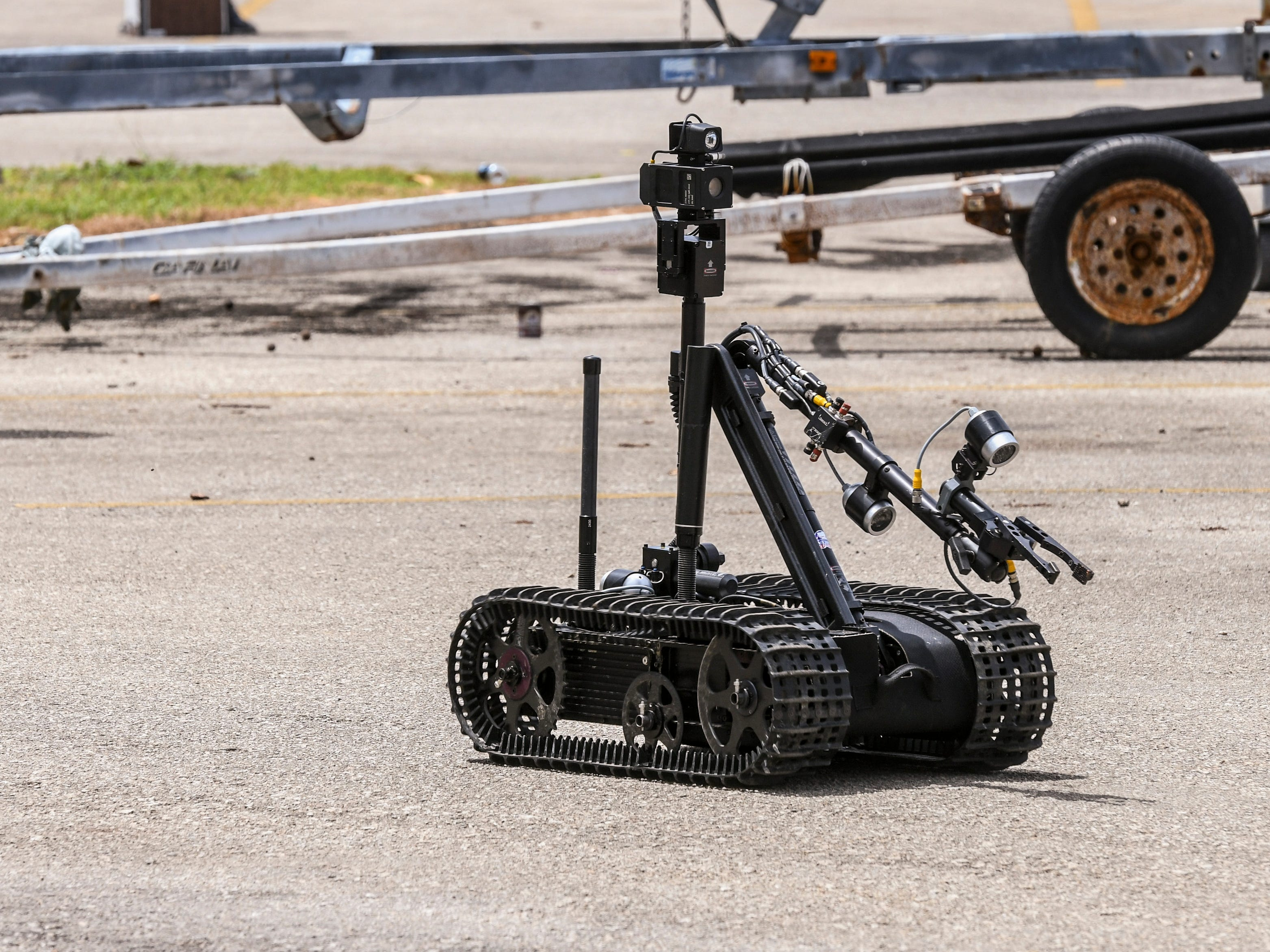 One of two radio-controlled bombs disposal robots can be seen returning to its transport vehicle as local and federal law enforcement agencies prepare to conclude their initial investigation of a suspicious device found outside the Guam Fire Department Rescue Base at the Agat Marina compound on Tuesday, March 12, 2019.
