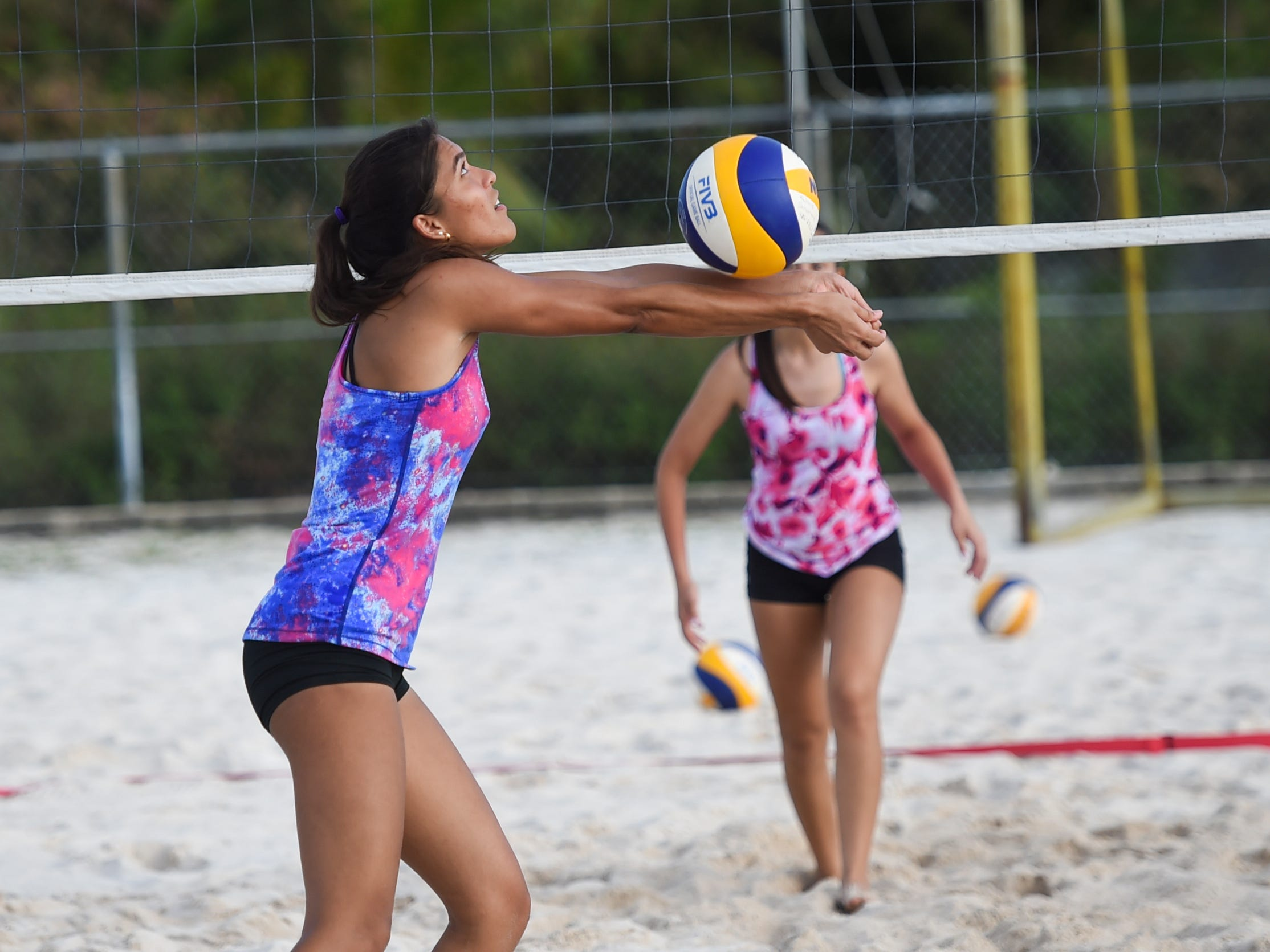 St. John's Knights White's Laressa Halladay bumps the ball during the IIAAG Beach Volleyball third place game at the Guam Football Association National Training Center in Dededo, March 12, 2019.