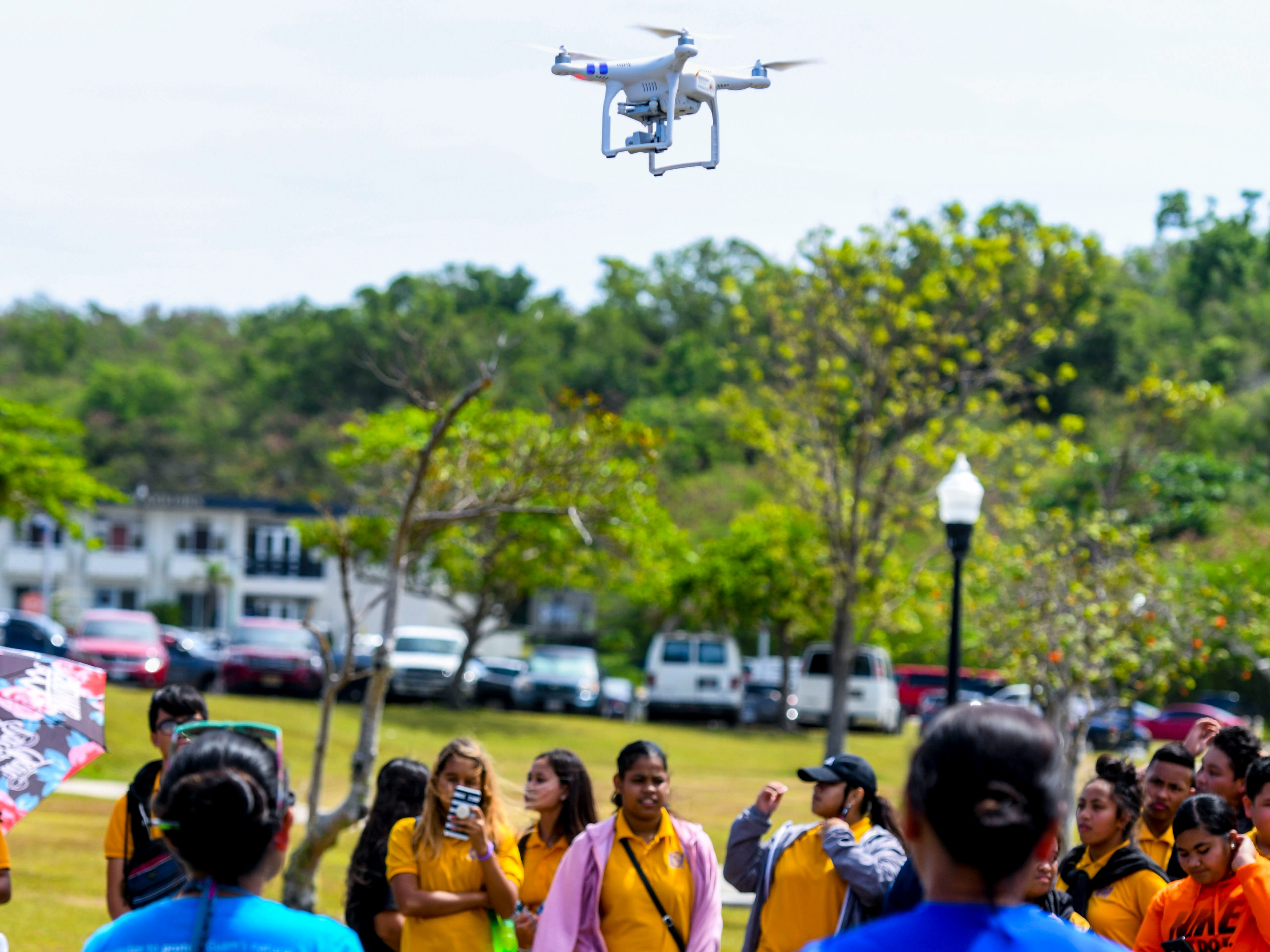 Unmanned Aerial Vehicle Organization President Cassandra Flores offers a flying demonstration during the University of Guam 51st Charter Day celebration in Mangilao on Tuesday, March 12, 2019.