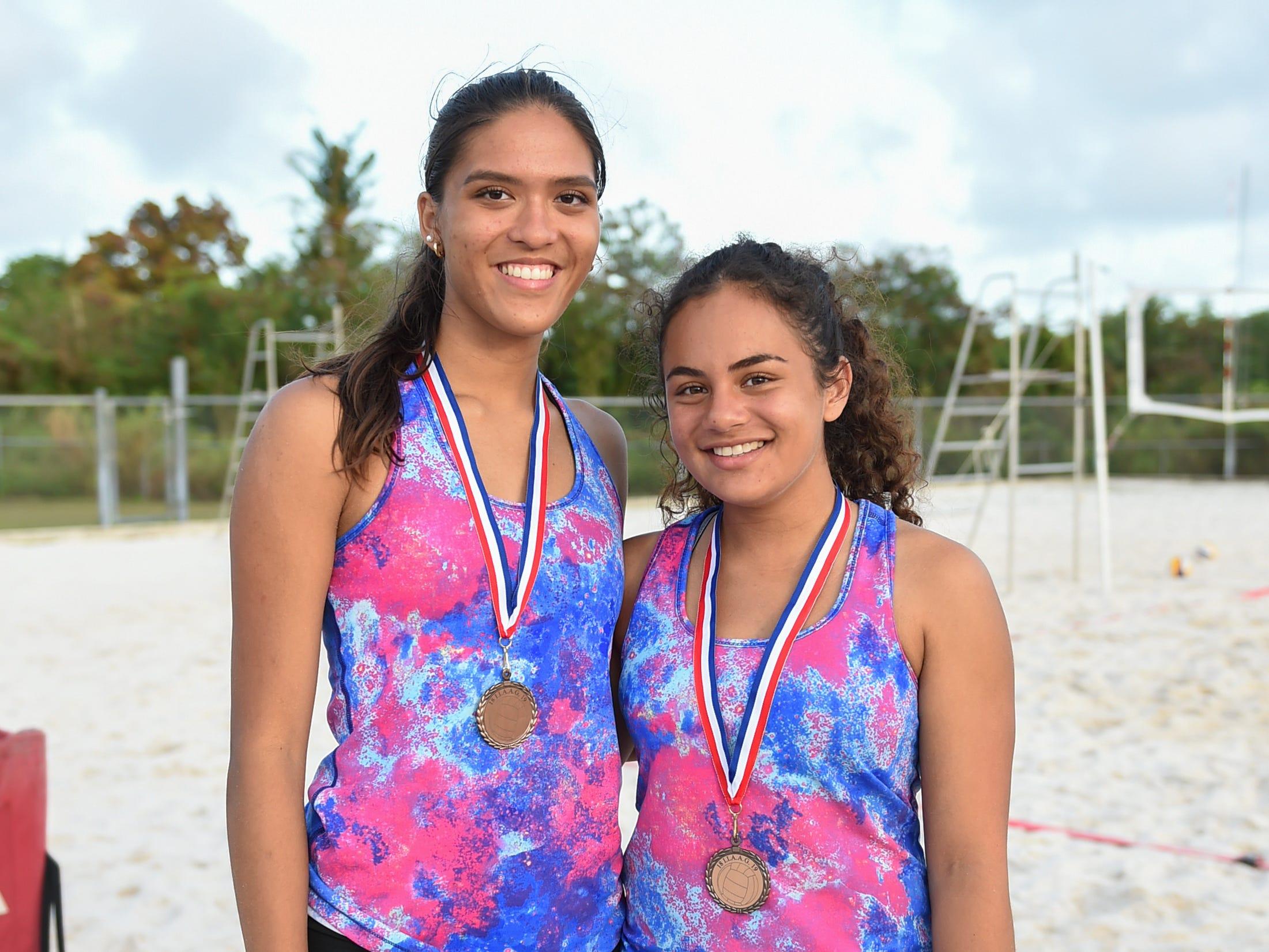 St. John's players Laressa Hallday, left, and Hana Fernandez following their IIAAG Beach Volleyball third place finish at the Guam Football Association National Training Center in Dededo, March 12, 2019.