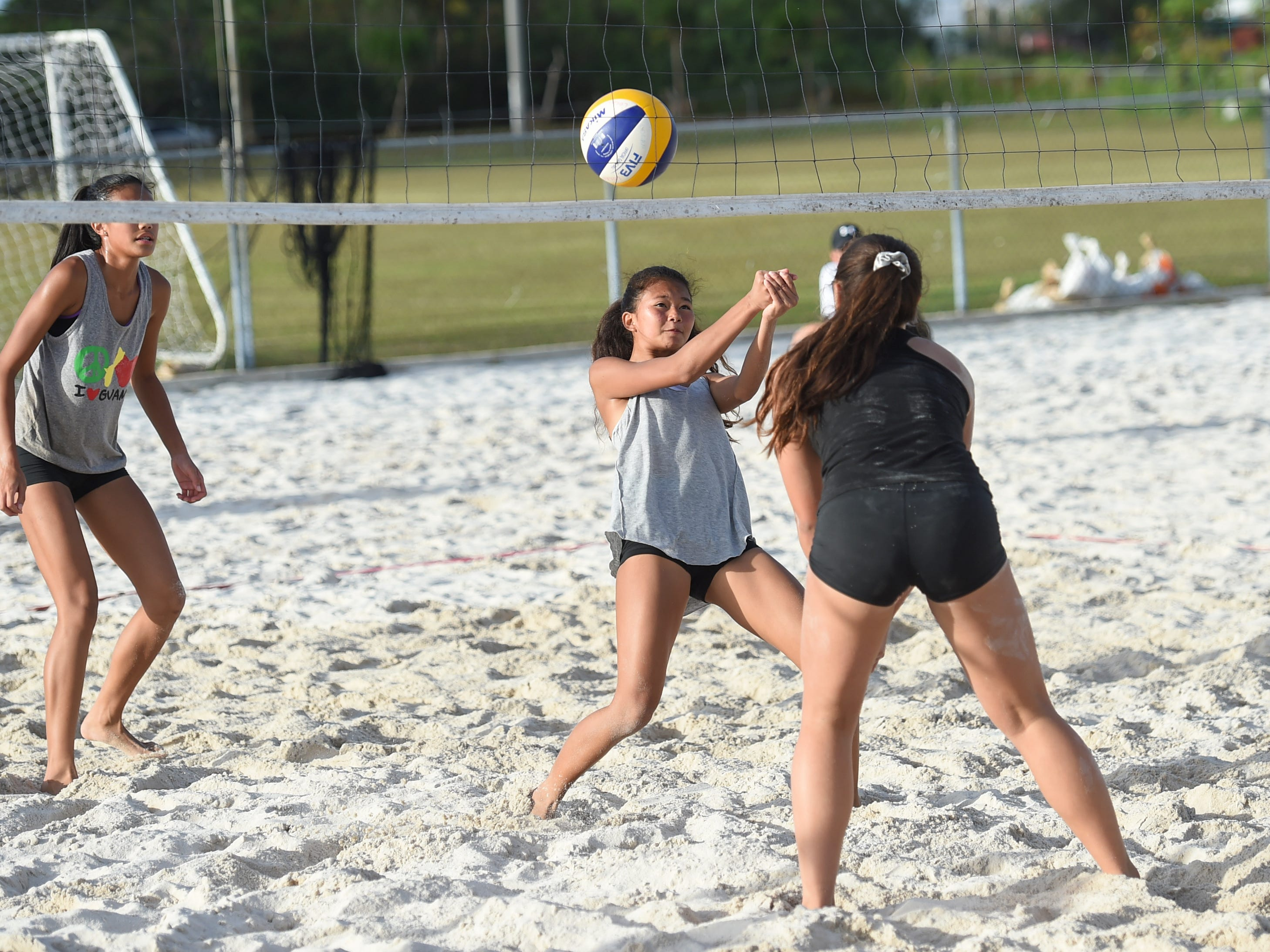 Yasmeen Lopez attempts to volley the ball during the IIAAG Beach Volleyball championship game at the Guam Football Association National Training Center in Dededo, March 12, 2019.