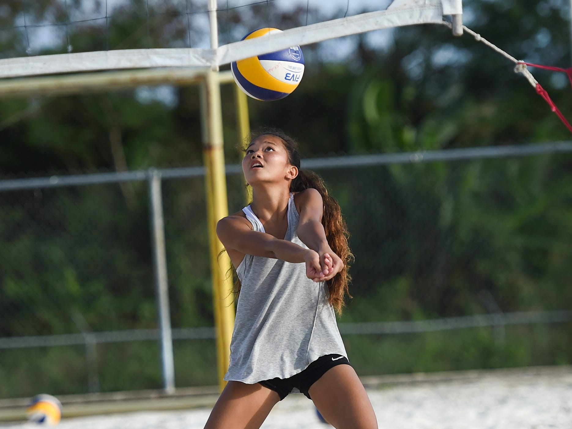 St. John's White's Yasmeen Lopez bumps during the IIAAG Beach Volleyball championship game at the Guam Football Association National Training Center in Dededo, March 12, 2019.