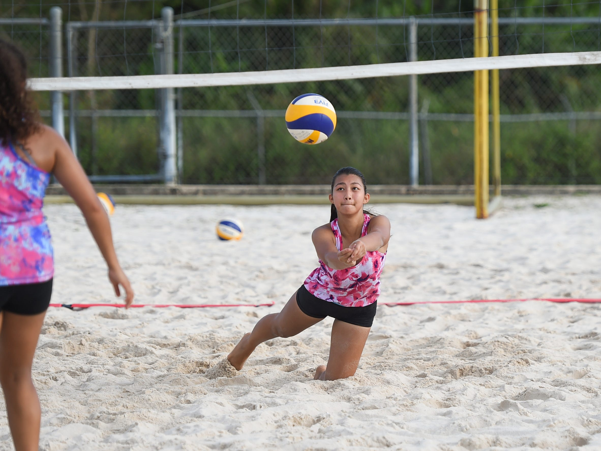 St. John's player Aileen Tseng digs on a play during the IIAAG Beach Volleyball third place game at the Guam Football Association National Training Center in Dededo, March 12, 2019.