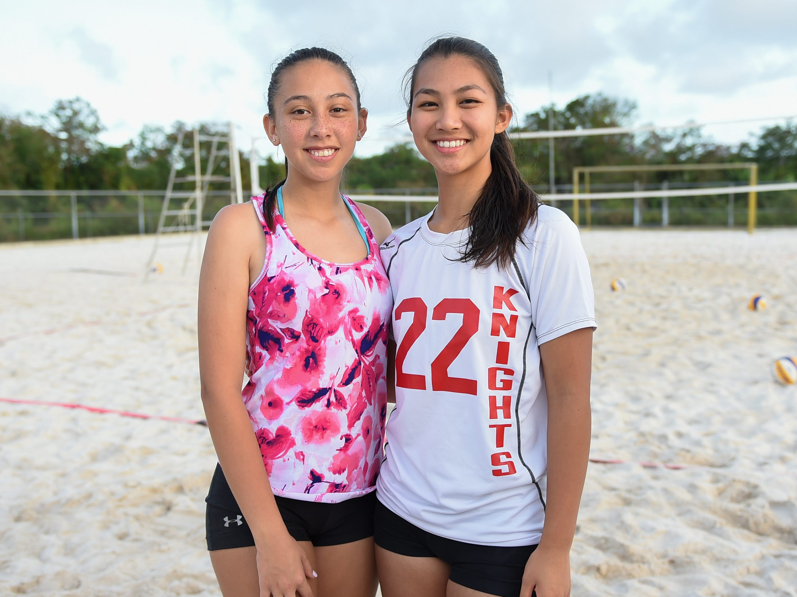 St. John's players Aileen Tseng, right, and Elisabeth Errett following the IIAAG Beach Volleyball championship game at the Guam Football Association National Training Center in Dededo, March 12, 2019.