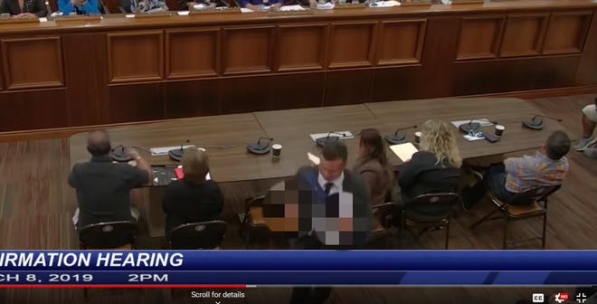 This screenshot from the legislature's live feed of the confirmation hearing shows Troy Torres, former Adelup communication director, showing the middle finger toward Dan Tydingco, appointed  to the A.B. Won Pat International Airport Authority's board of directors, at Tydingco's confirmation hearing on March 8, 2019.