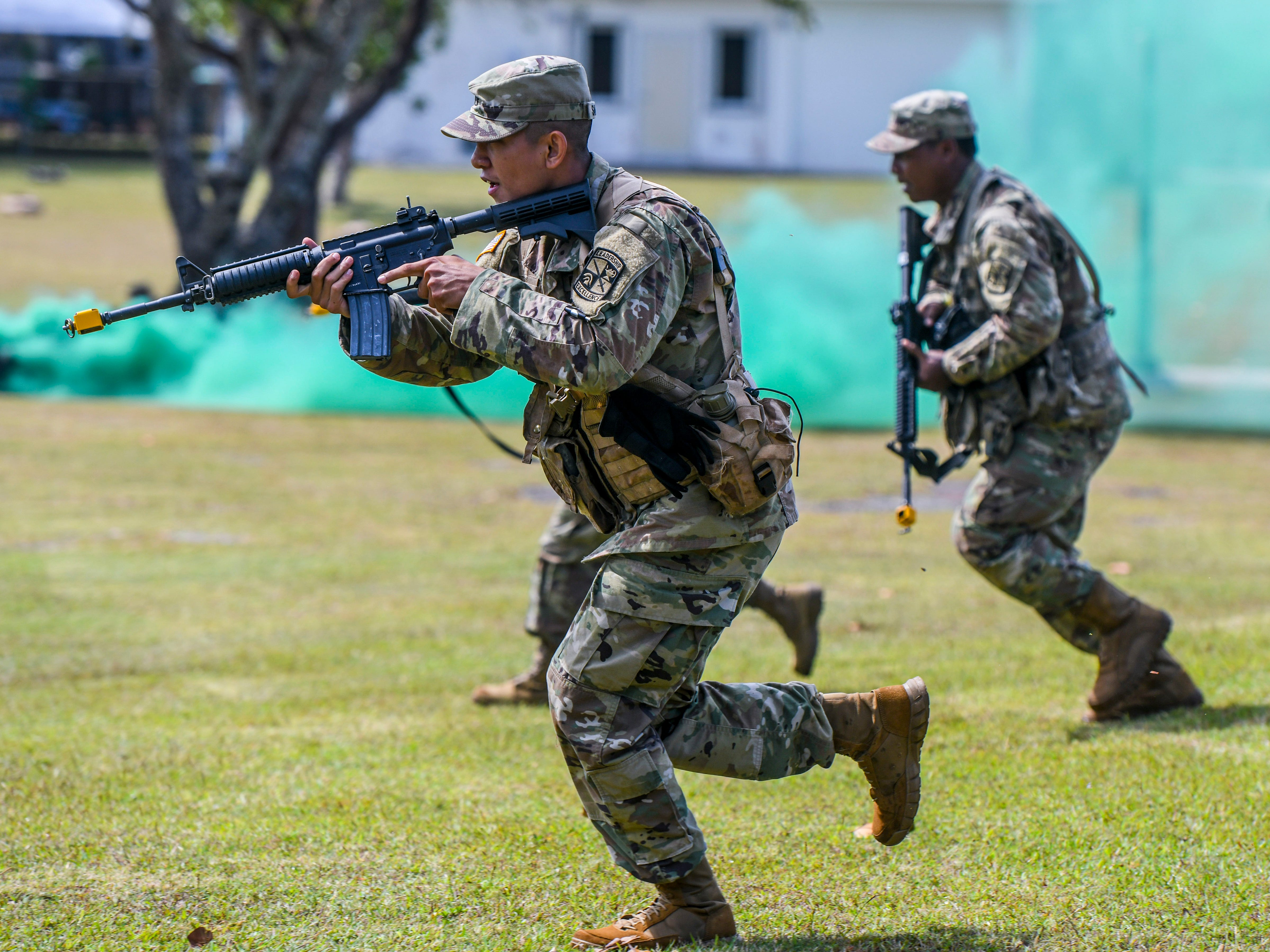 Army ROTC cadets demonstrate their skills during a mock battlefield engagement during the University of Guam 51st Charter Day celebration in Mangilao on Tuesday, March 12, 2019.