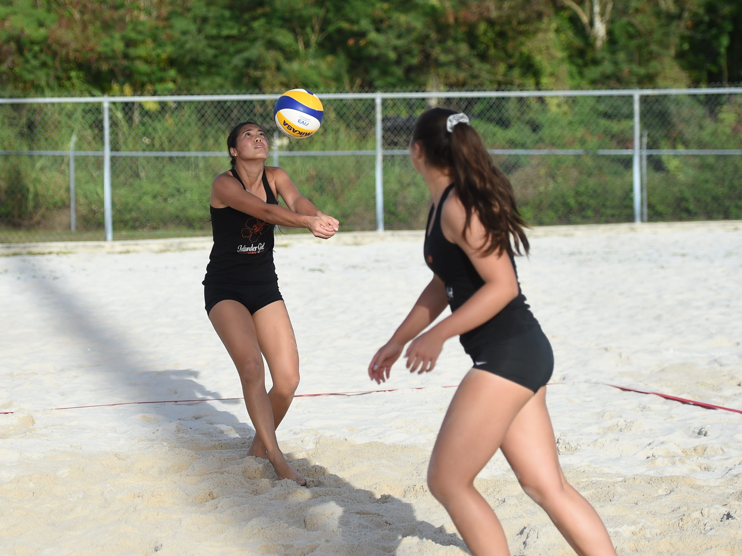 St. John's White's Hallie Wigsten bumps the ball during the IIAAG Beach Volleyball championship game at the Guam Football Association National Training Center in Dededo