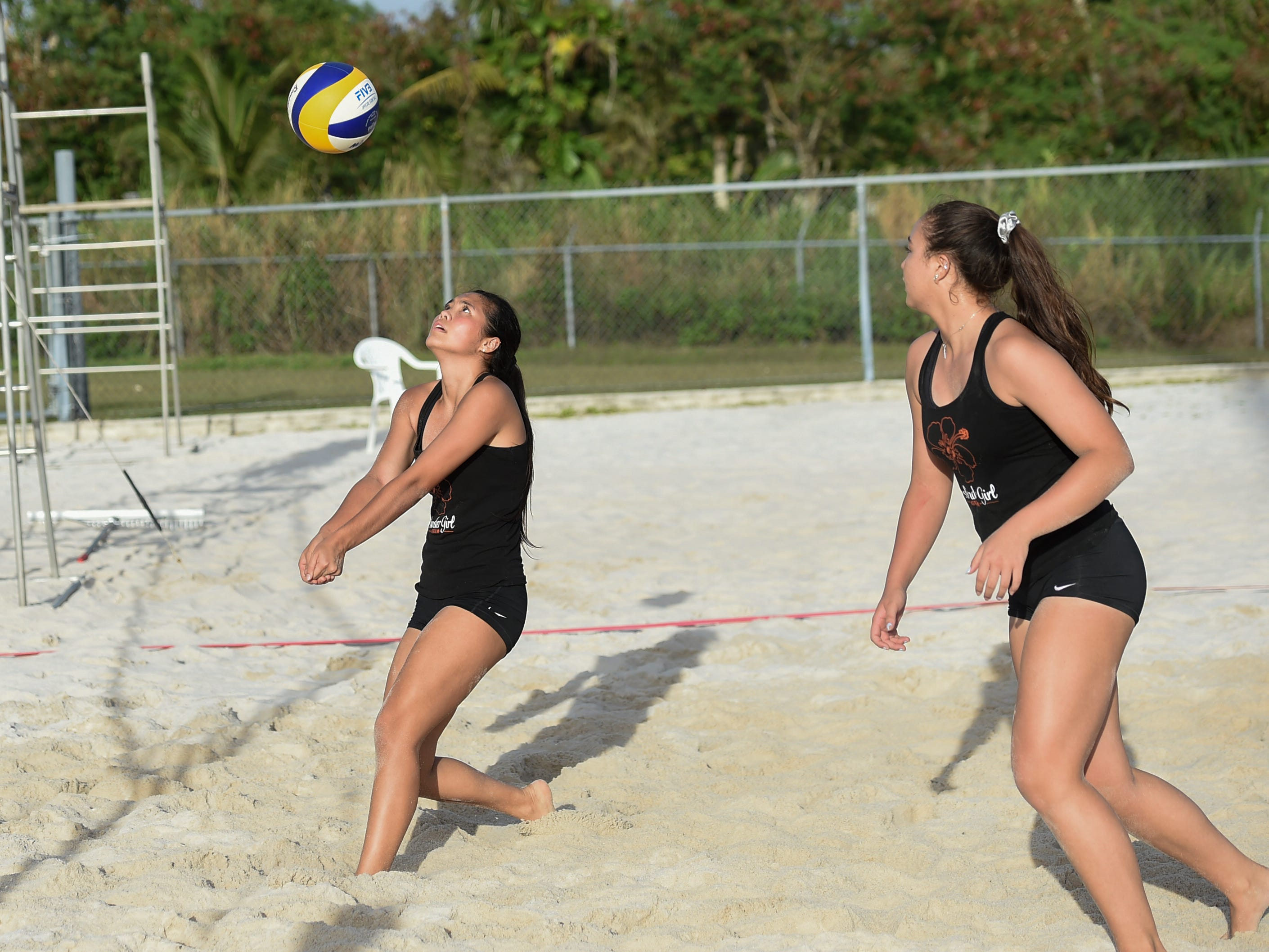 The St. John's duo of Hallie Wigsten, left, and Tylee Shepherd compete during the IIAAG Beach Volleyball championship game at the Guam Football Association National Training Center in Dededo, March 12, 2019.