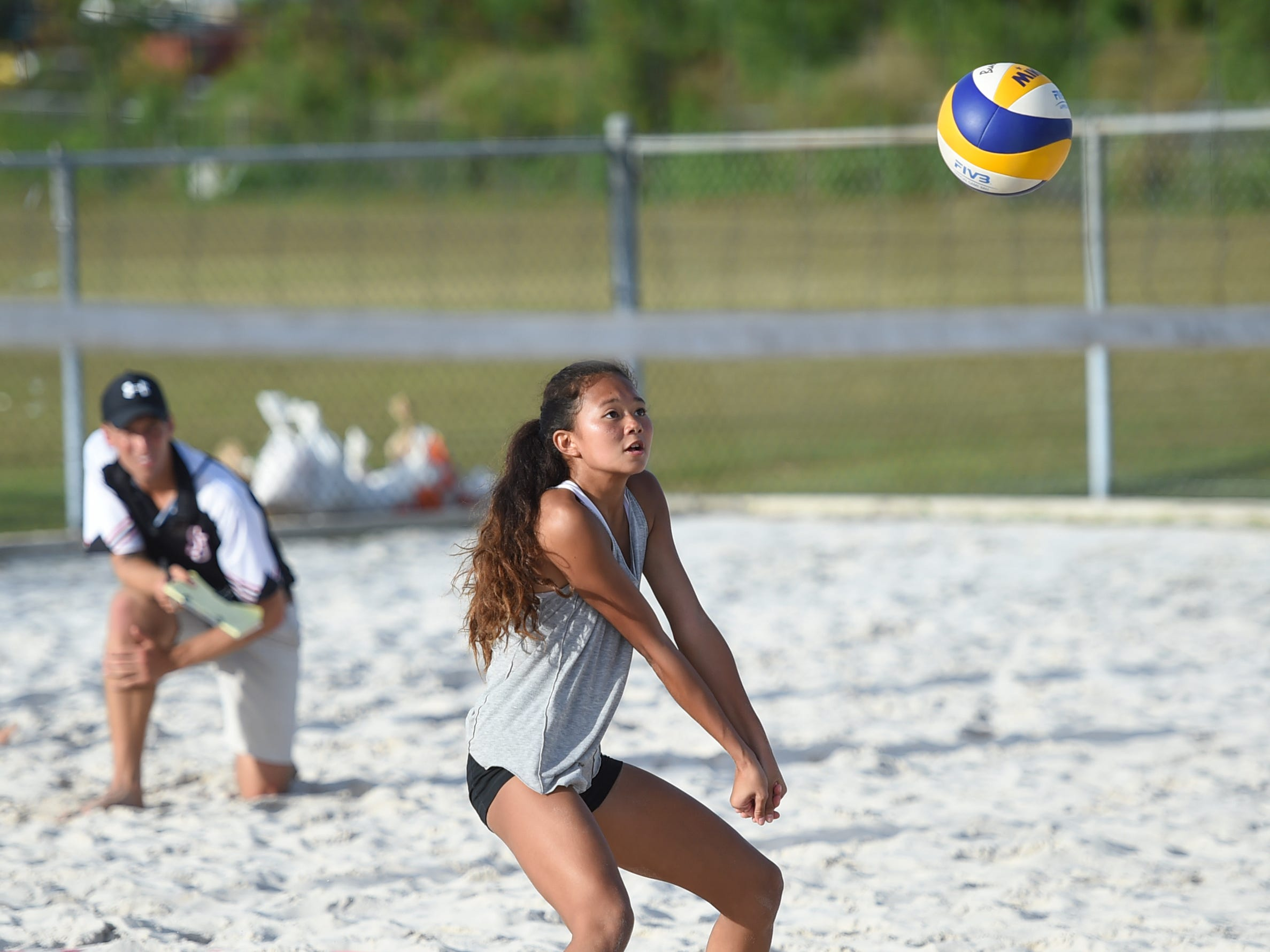 St. John's player Yasmeen Lopez anticipates the ball during the IIAAG Beach Volleyball championship game at the Guam Football Association National Training Center in Dededo, March 12, 2019.