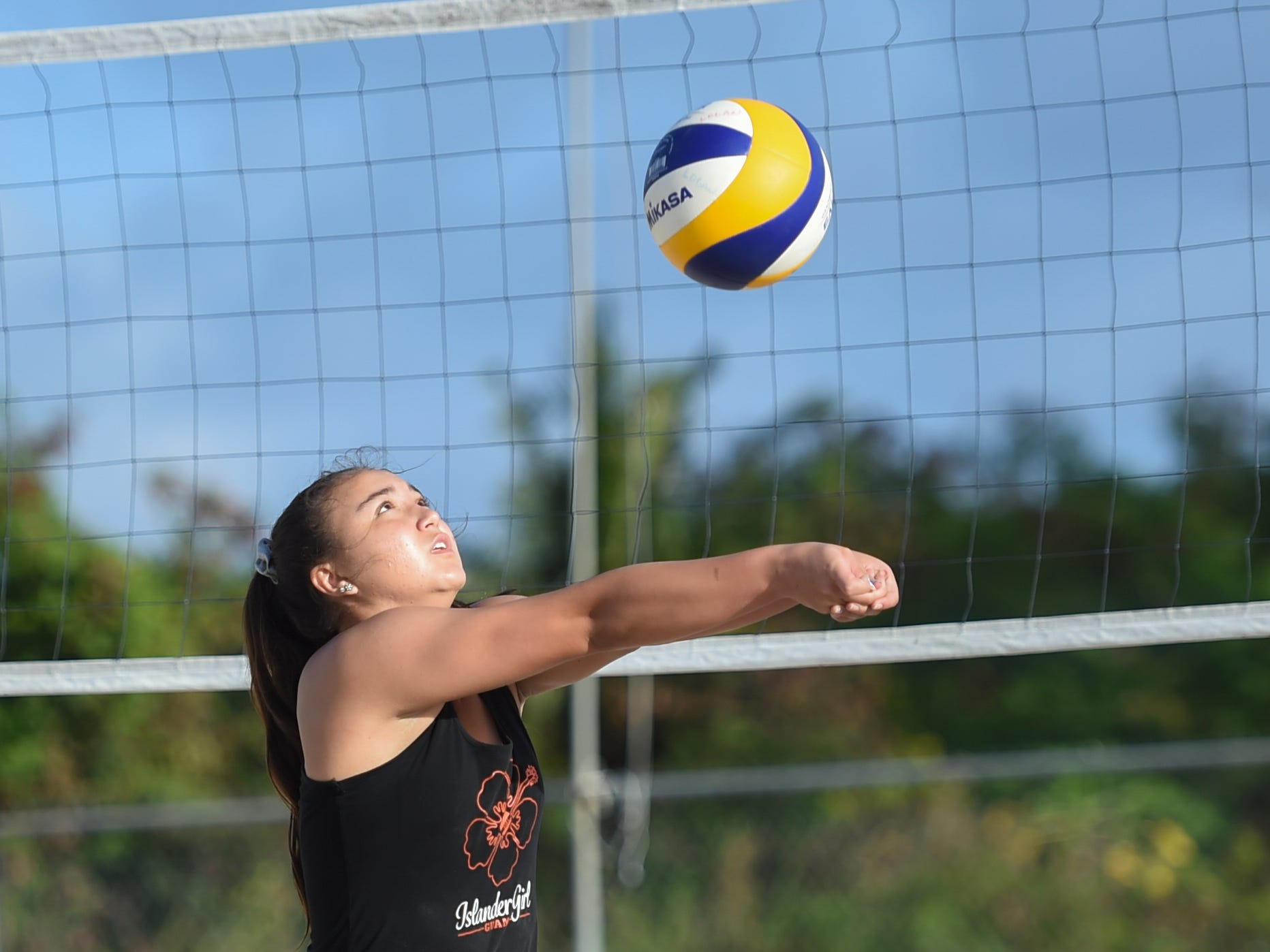 St. John's White's Tylee Shepherd bumps the ball during the IIAAG Beach Volleyball championship game at the Guam Football Association National Training Center in Dededo, March 12, 2019.