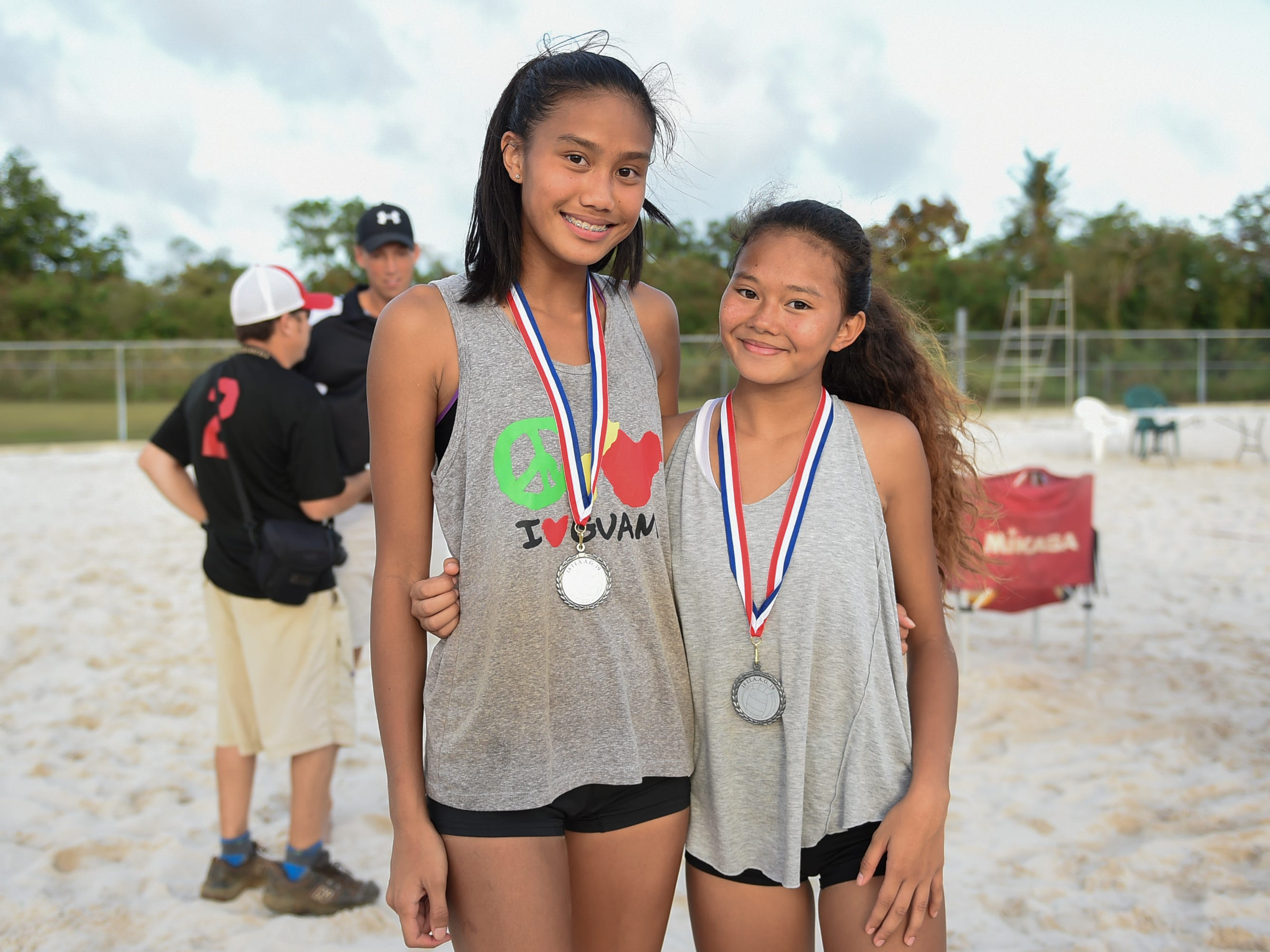 St. John's teammates Kristen Serrano, left, and Yasmeen Lopez after their IIAAG Beach Volleyball championship game at the Guam Football Association National Training Center in Dededo, March 12, 2019.