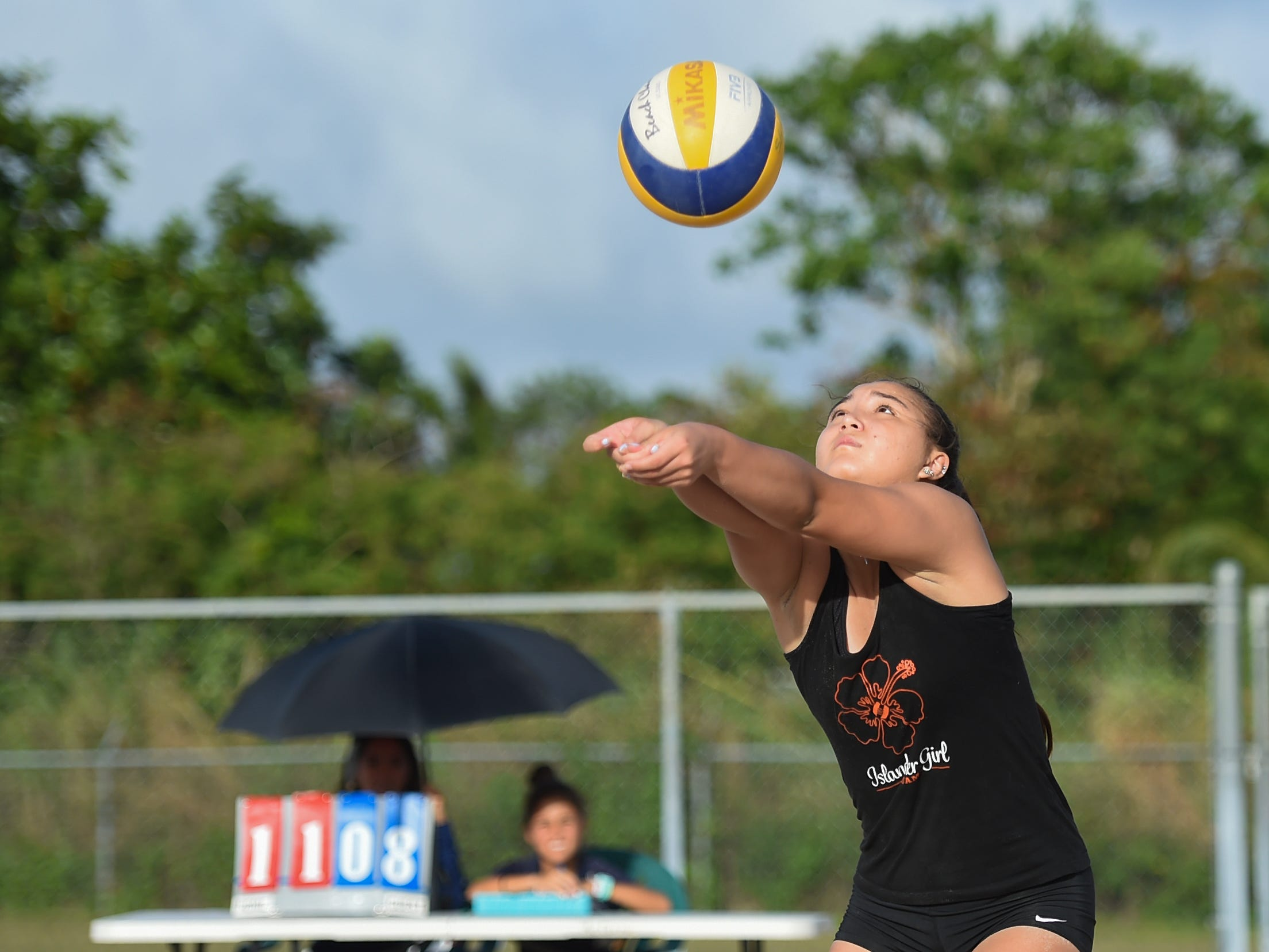 St. John's White's Tylee Shepherd times a bump during the IIAAG Beach Volleyball championship game at the Guam Football Association National Training Center in Dededo