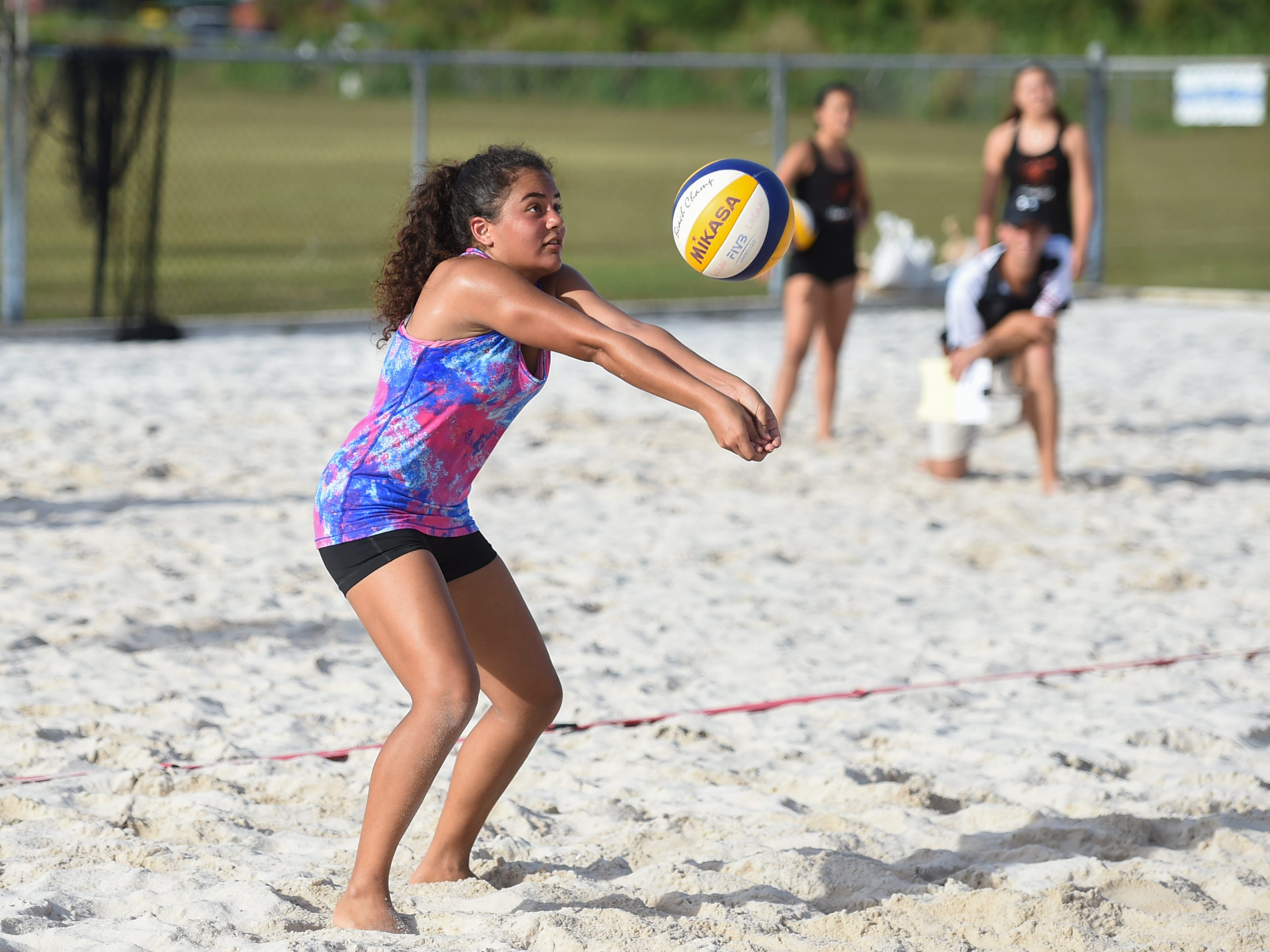 Hana Fernandez of the St. John's Knights White team, competes during the IIAAG Beach Volleyball third place game at the Guam Football Association National Training Center in Dededo, March 12, 2019.