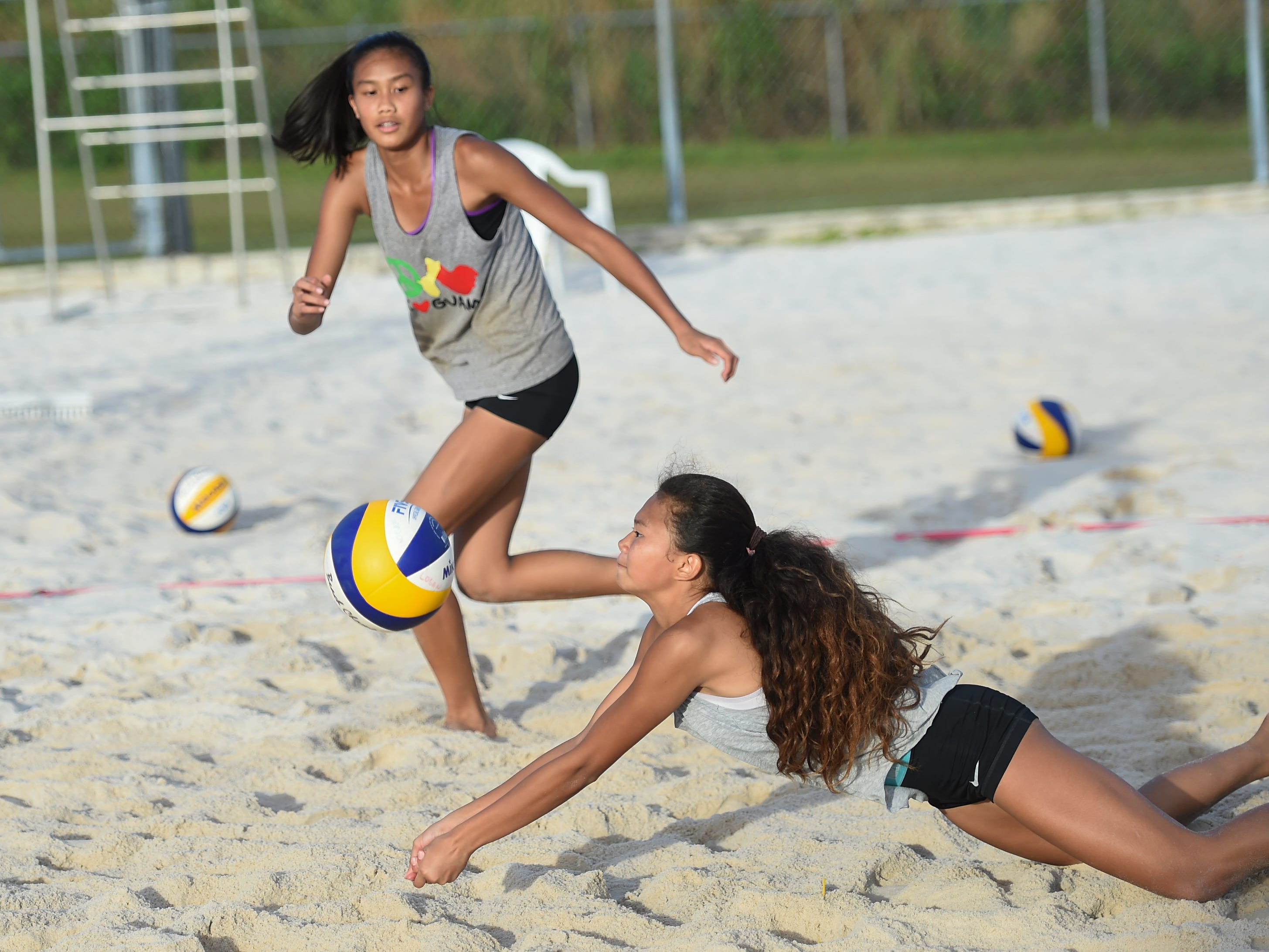 St. John's White's Yasmeen Lopez digs on a play during the IIAAG Beach Volleyball championship game at the Guam Football Association National Training Center in Dededo, March 12, 2019.