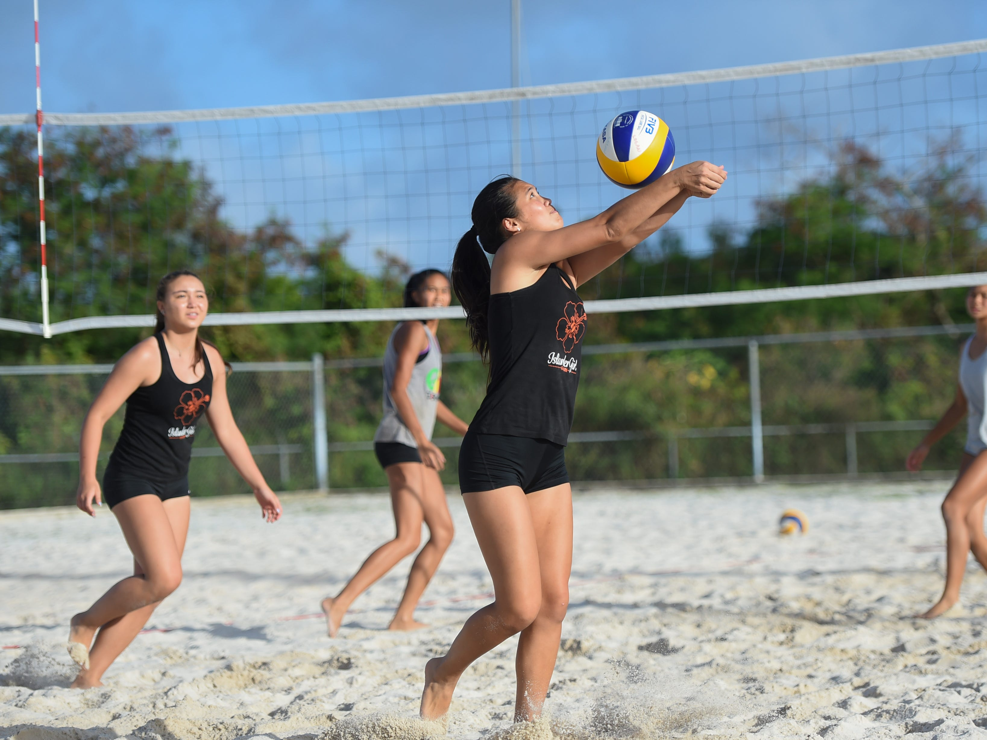 St. John's White's Hallie Wigsten bumps the ball during the IIAAG Beach Volleyball championship game at the Guam Football Association National Training Center in Dededo, March 12, 2019.