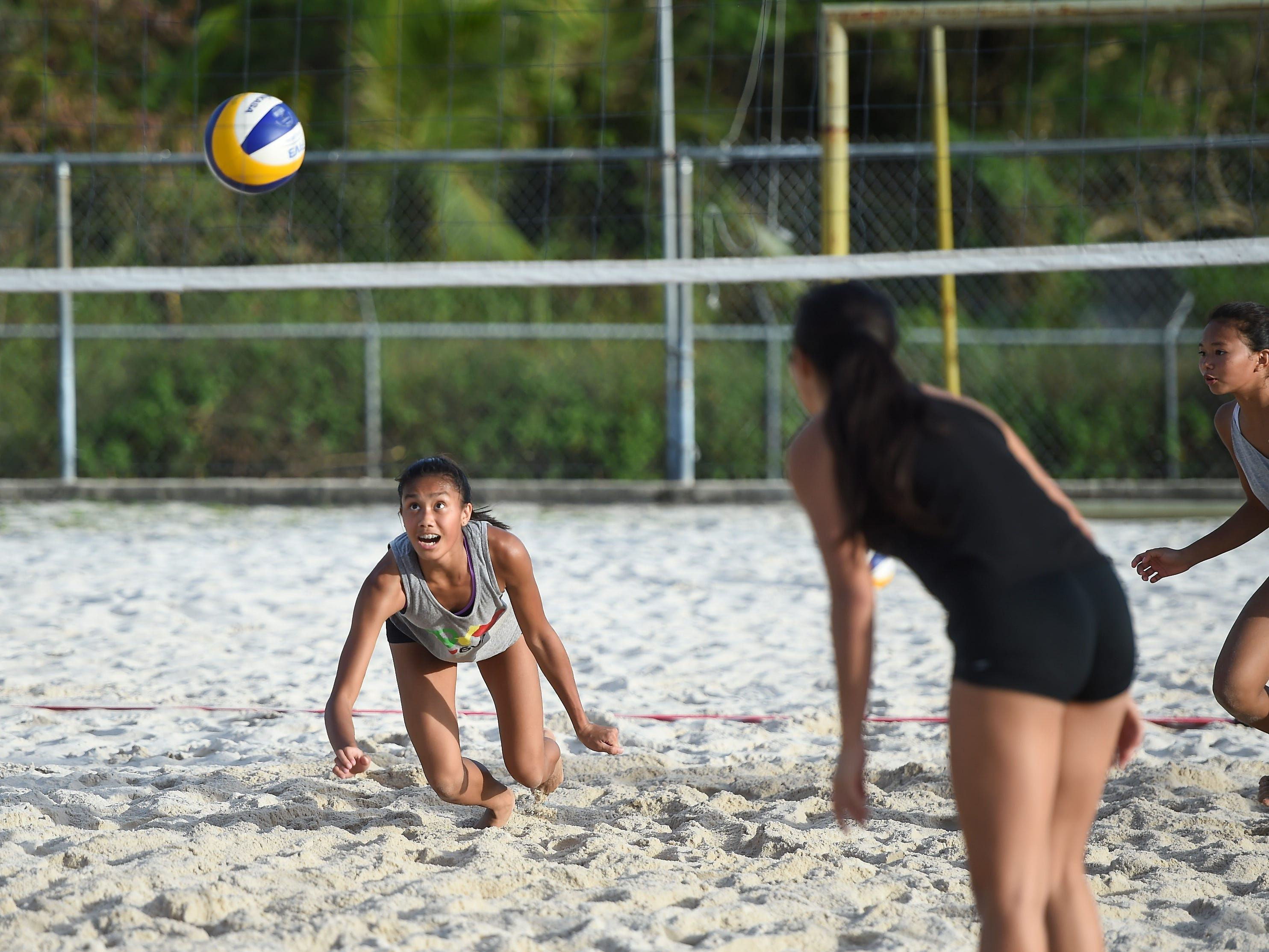 Kristen Serranodives on a play during the IIAAG Beach Volleyball championship game at the Guam Football Association National Training Center in Dededo, March 12, 2019.