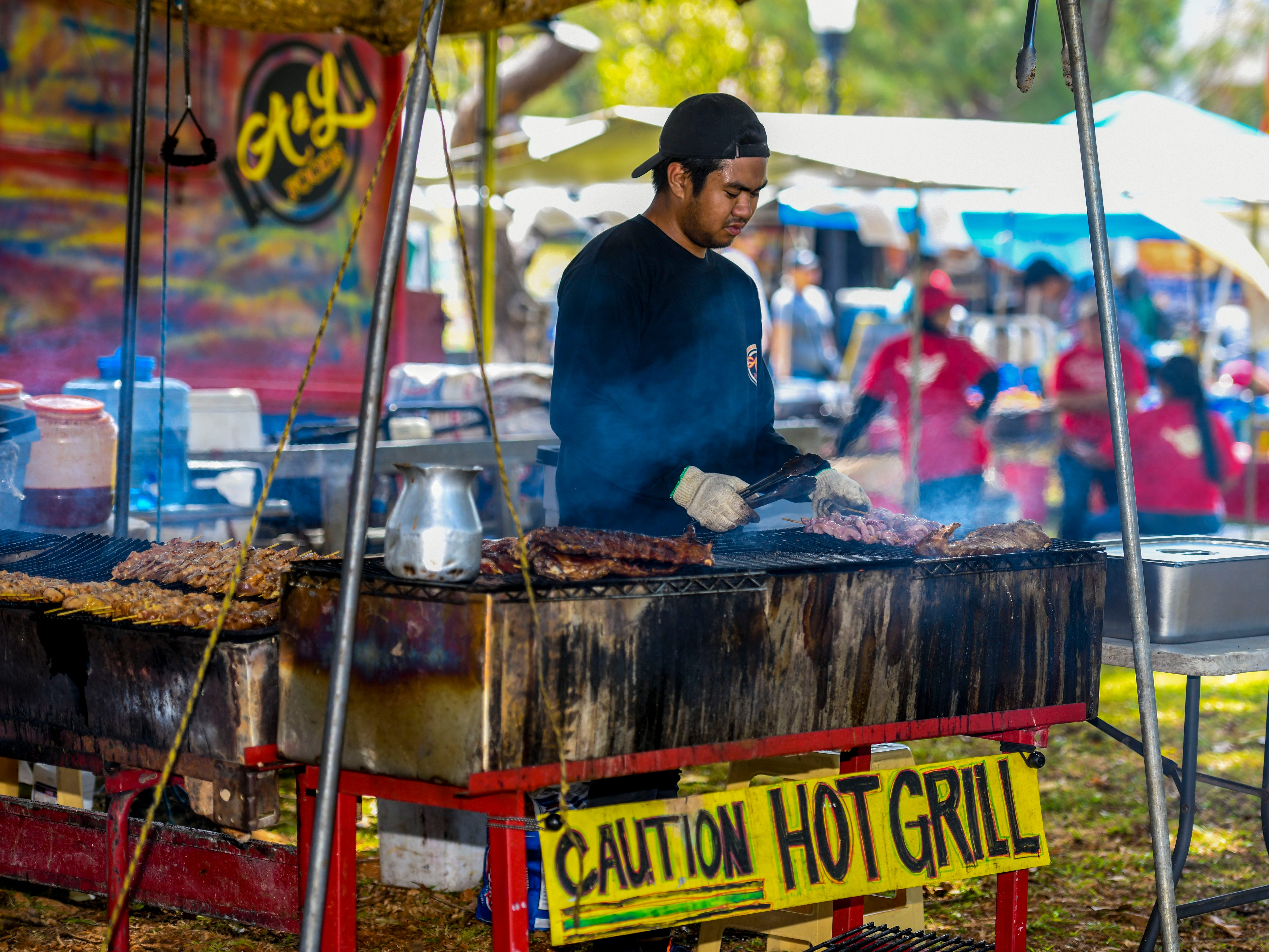 A&L Food's Paolo De Goma grills up some ribs and shishkabobs during the University of Guam's 51st Charter Day celebration in Mangilao on Tuesday, March 12, 2019.