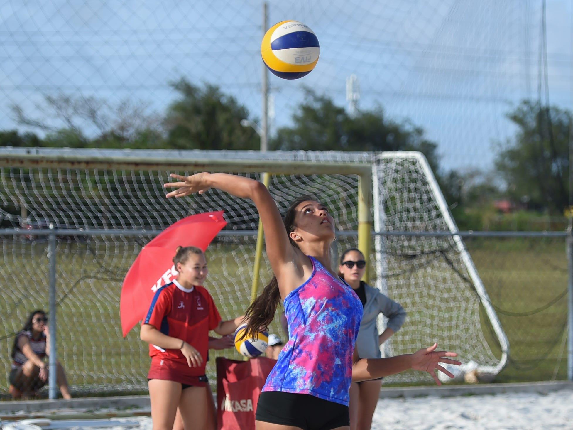 St. John's Knights White's Laressa Halladay serves during the IIAAG Beach Volleyball third place game at the Guam Football Association National Training Center in Dededo, March 12, 2019.