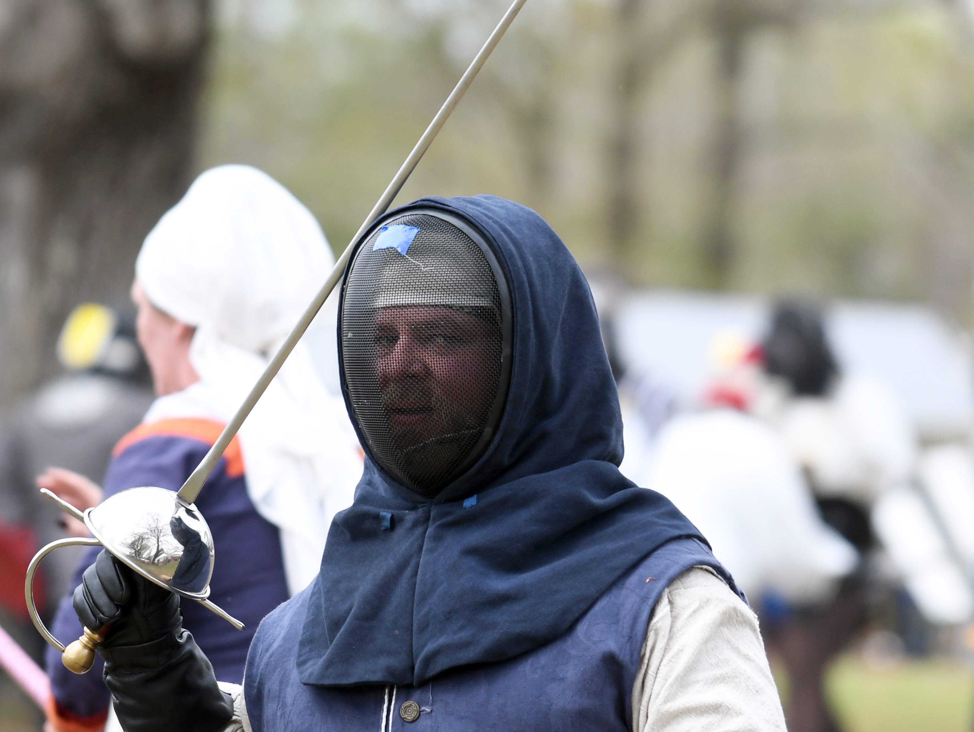 Participants battle in a fencing match during Gulf Wars XXVIII at King's Arrow Ranch in Lumberton on Monday. March 11, 2019.