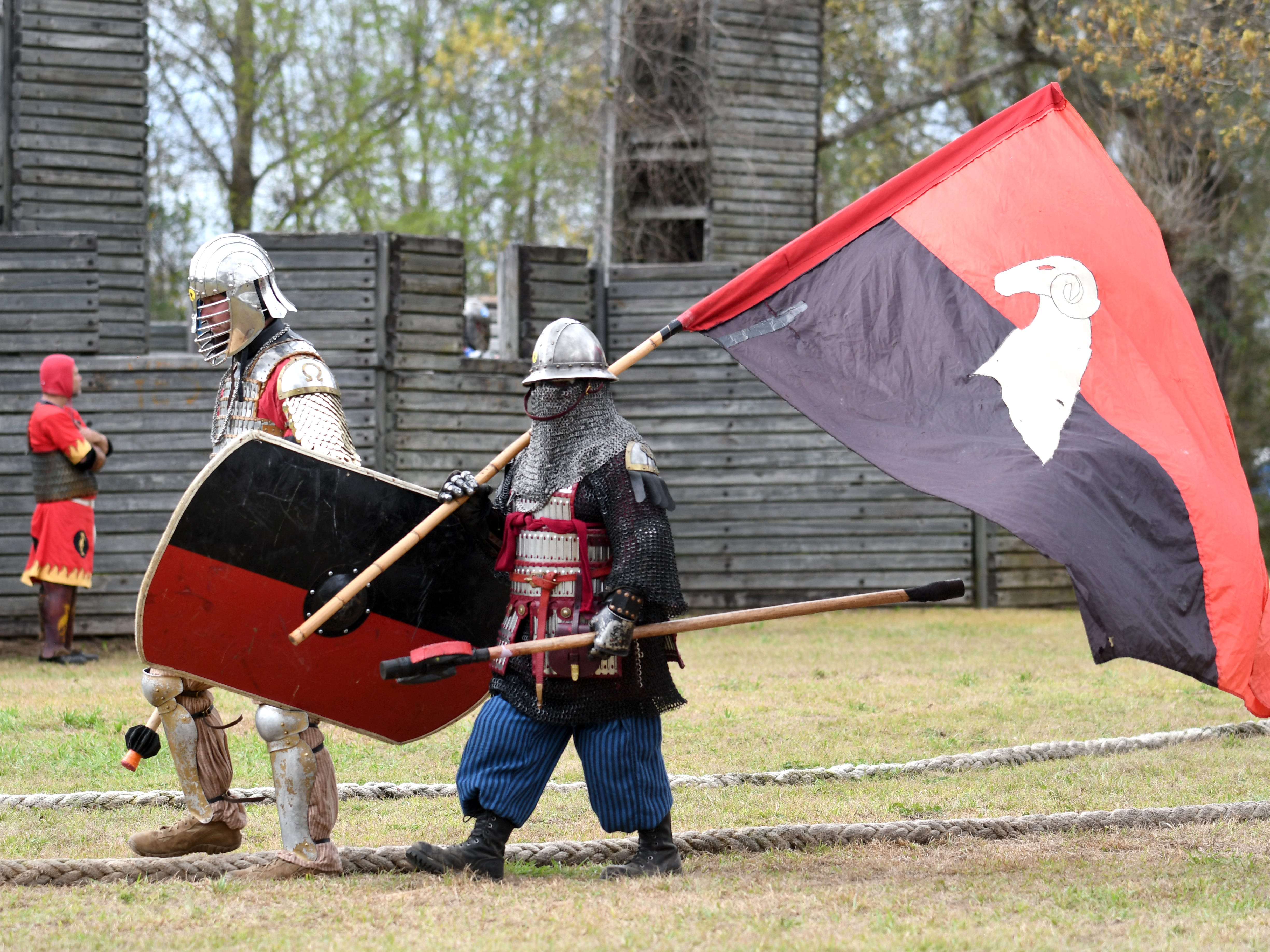 Armed fighters prepare for a field battle during Gulf Wars XXVIII at King's Arrow Ranch in Lumberton on Monday, March 11, 2019.