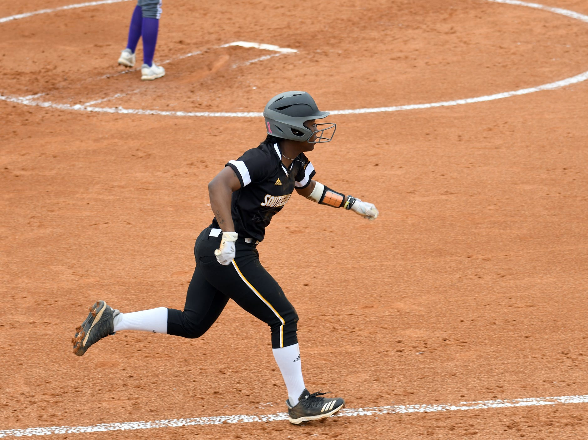 Southern Miss infielder Alyssa Davis runs to first base in a game against Alcorn on Tuesday, March 12, 2019.