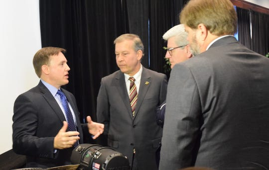 From left, Kohler Engines President Brian Melka talks about the company's engines with Forrest County Supervisor David Hogan, Gov. Phil Bryant and ADP board president Chad Driskell.
