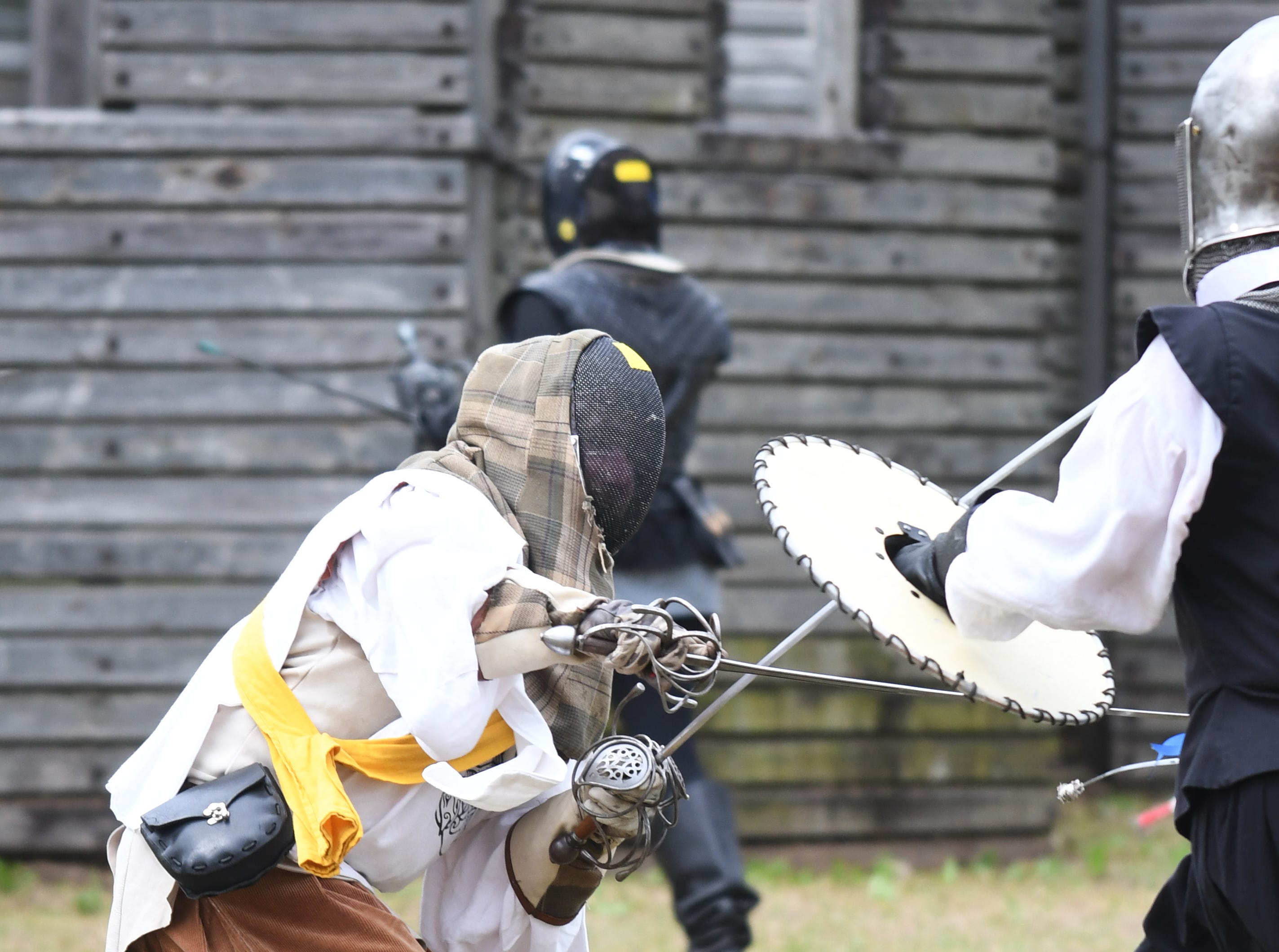 Participants battle in a fencing match during Gulf Wars XXVIII at King's Arrow Ranch in Lumberton on Monday, March 11, 2019.