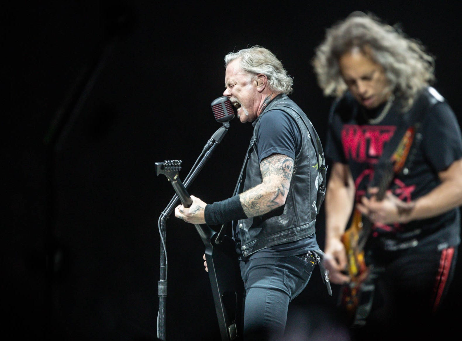Metallica members James Hetfield, left, and Kirk Hammett perform as the band brings their WorldWired Tour to Bankers Life Fieldhouse on Monday, March 11, 2019.