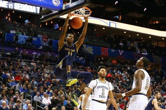 Mar 12, 2019; Charlotte, NC, USA; Notre Dame Fighting Irish forward Juwan Durham (11) dunks the ball in the first half against the Georgia Tech Yellow Jackets in the ACC Conference Tournament at Spectrum Center.