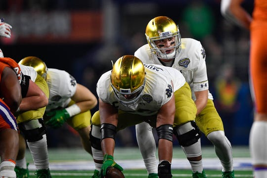 Notre Dame center Sam Mustipher (center) was a finalist for the Rimington Award.