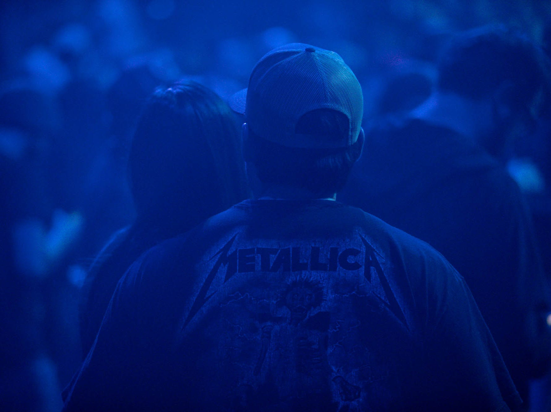 Metallica fans rock concert T's as the band brings their WorldWired Tour to Bankers Life Fieldhouse on Monday, March 11, 2019.