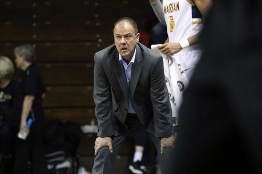 Marian Head Coach, Scott Heady looks on during Monday's NAIA semifinal game against Spring Arbor in Sioux Falls, SD.
