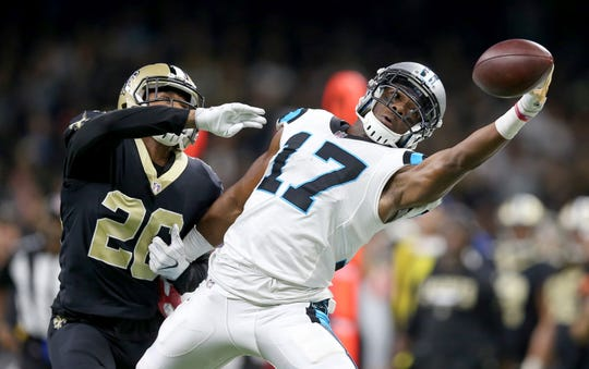Dec 3, 2017; New Orleans, LA, USA; Carolina Panthers wide receiver Devin Funchess (17) can't make a catch while defended by New Orleans Saints cornerback P.J. Williams (26) in the second half at the Mercedes-Benz Superdome. Williams was called for pass interference on the play.