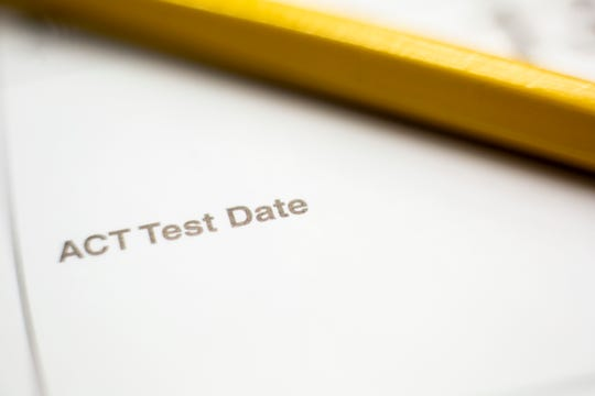 A yellow No. 2 pencil and ACT test date.