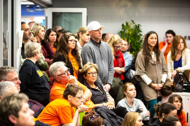 Teachers, community members and union supporters listen during a school board meeting on Monday, March 11, 2019, at the Solon Intermediate School, in Solon, Iowa.