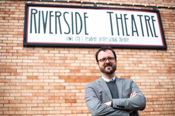 Adam Knight, artistic director at the Riverside Theatre, poses for a portrait on Tuesday, March 12, 2019, at Riverside Theatre on Gilbert Street in Iowa City, Iowa.