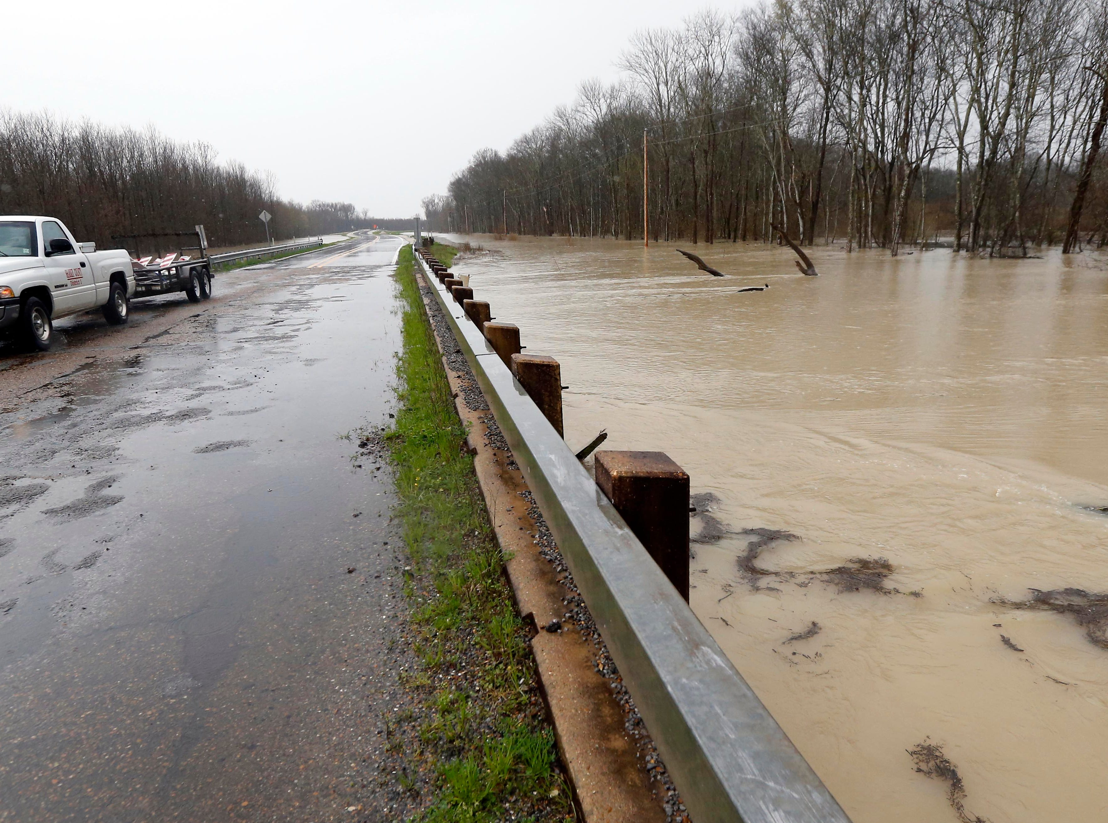 Backflow waters flood Mississippi 16 near Rolling Fork, Miss., Monday, March 11, 2019. This week the Federal Emergency Management Agency (FEMA), the Mississippi Emergency Management Agency (MEMA), along with select local emergency management offices will be conducting joint damage assessments in response to the severe storms and flooding are impacting the state. (AP Photo/Rogelio V. Solis)