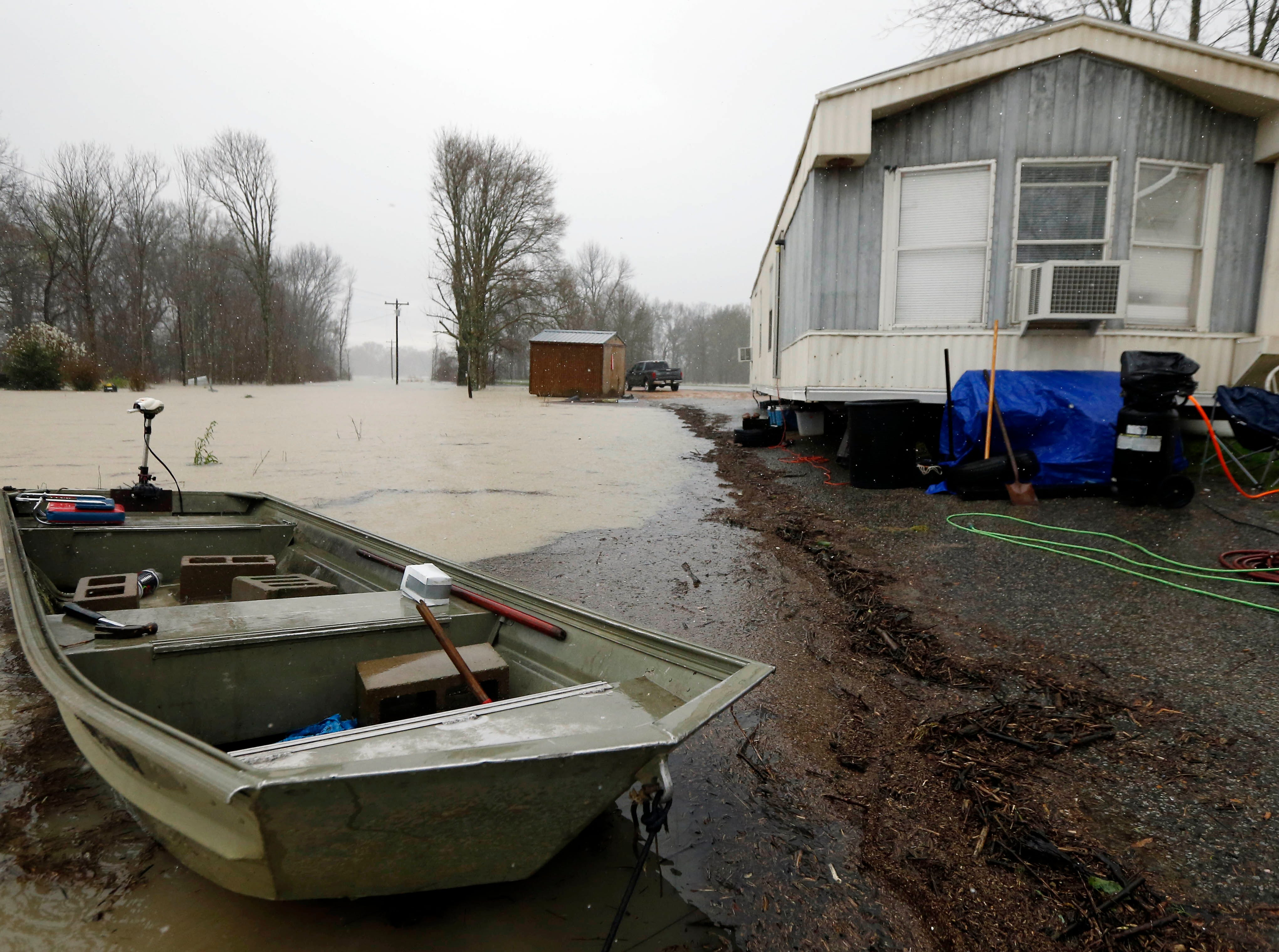 As backflow waters flood home property and farm land along Mississippi 16 near Rolling Fork, Miss., some residents have taken to using small boats to reach their homes, Monday, March 11, 2019. This week the Federal Emergency Management Agency (FEMA), the Mississippi Emergency Management Agency (MEMA), along with select local emergency management offices will be conducting joint damage assessments in response to the severe storms and flooding are impacting the state. (AP Photo/Rogelio V. Solis)