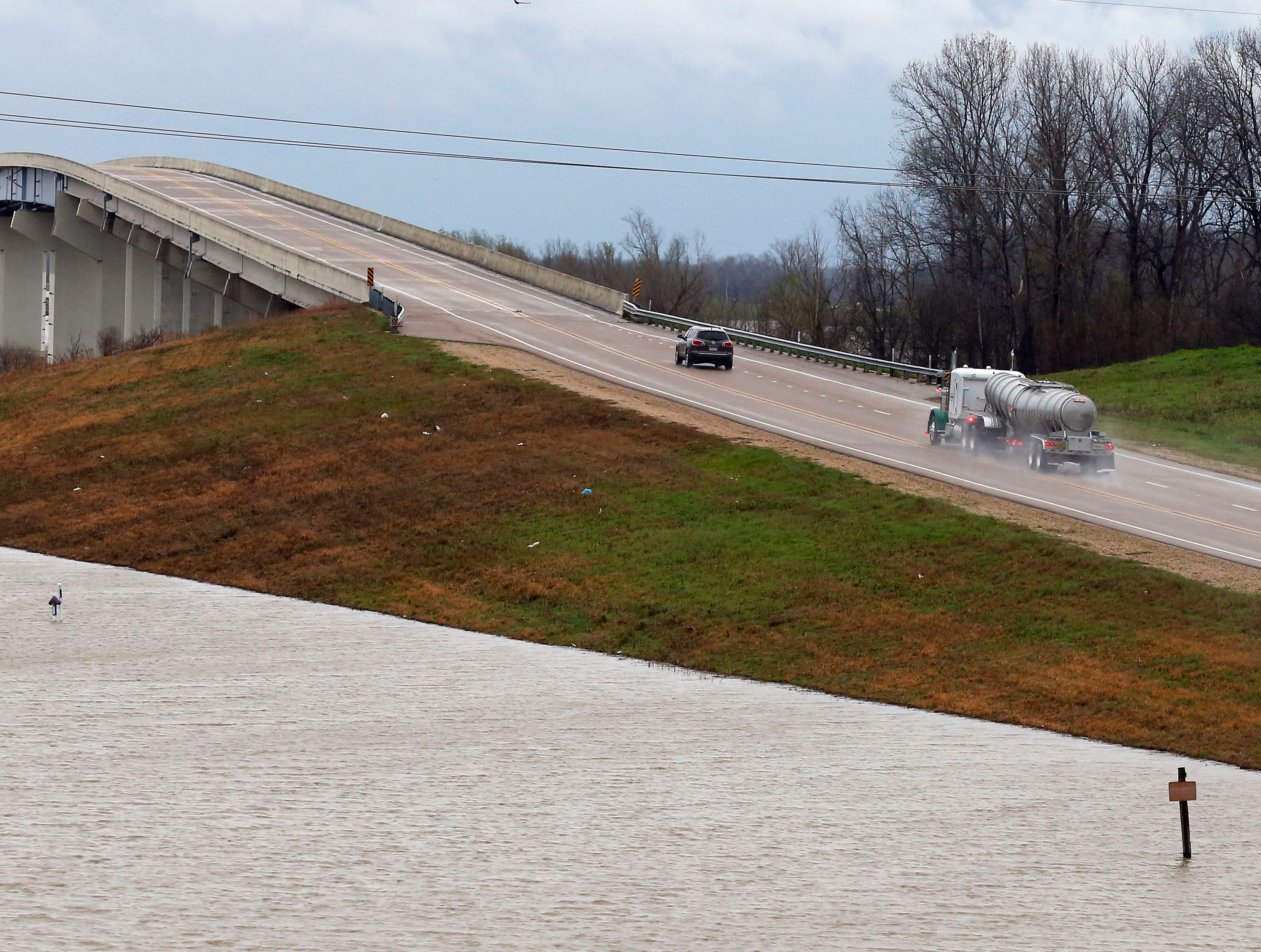 Yazoo River waters creep towards U.S. 61 in Redwood, Miss., Monday, March 11, 2019. This week the Federal Emergency Management Agency (FEMA), the Mississippi Emergency Management Agency (MEMA), along with select local emergency management offices will be conducting joint damage assessments in response to the severe storms and flooding are impacting the state. (AP Photo/Rogelio V. Solis)