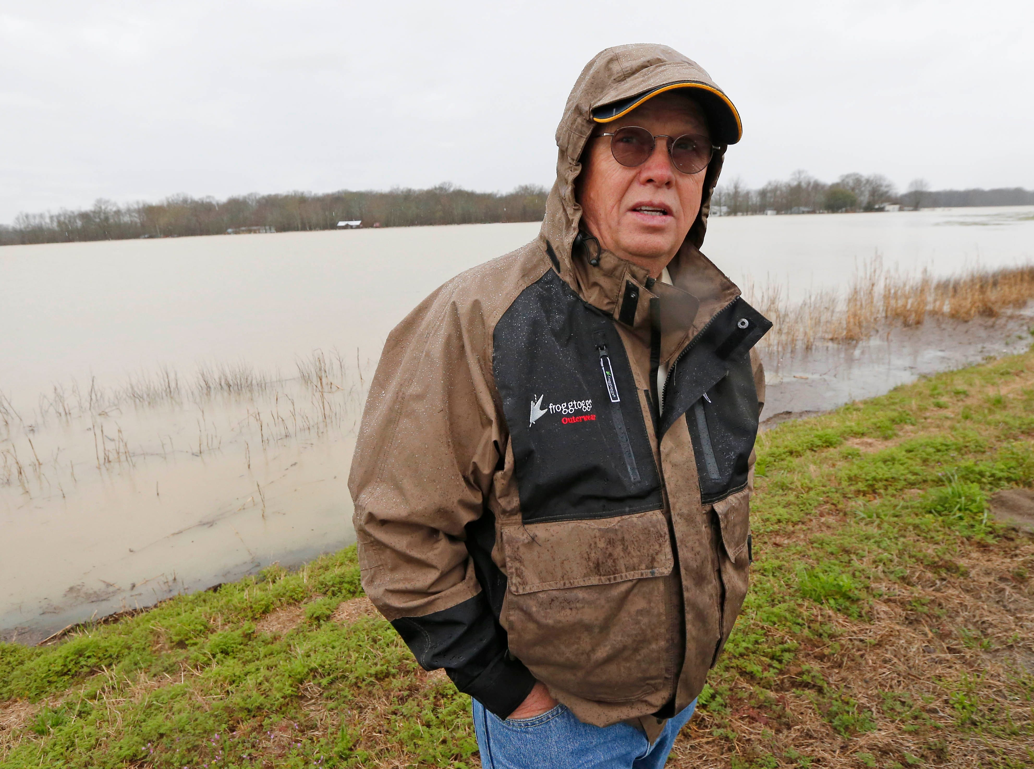"In this Monday, March 11, 2019 photo, Sharkey County Supervisor Bill Newsom stands before a ""lake"" of flood water that sits on top of farm lands usually covered with soybeans, near Rolling Fork, Miss. Newsom is an advocate of giant pumps that would move water out of the area, pushing it over the levee into a flooded Mississippi. (AP Photo/Rogelio V. Solis)"
