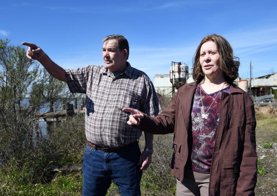 Jerry and Maria Blair of Theodore, Alabama, look over the Pascagoula River where they say they saw the spacecraft that Calvin Parker and Charles Hickson claim they were taken aboard after being abducted by aliens in 1973.