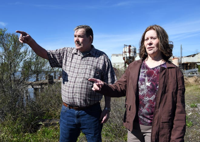 Photographed in 2019, Jerry, now deceased, and Maria Blair of Theodore, Alabama, look over the Pascagoula River where they say they saw the spacecraft that Calvin Parker and Charles Hickson claim they were taken aboard after being abducted by aliens in 1973.